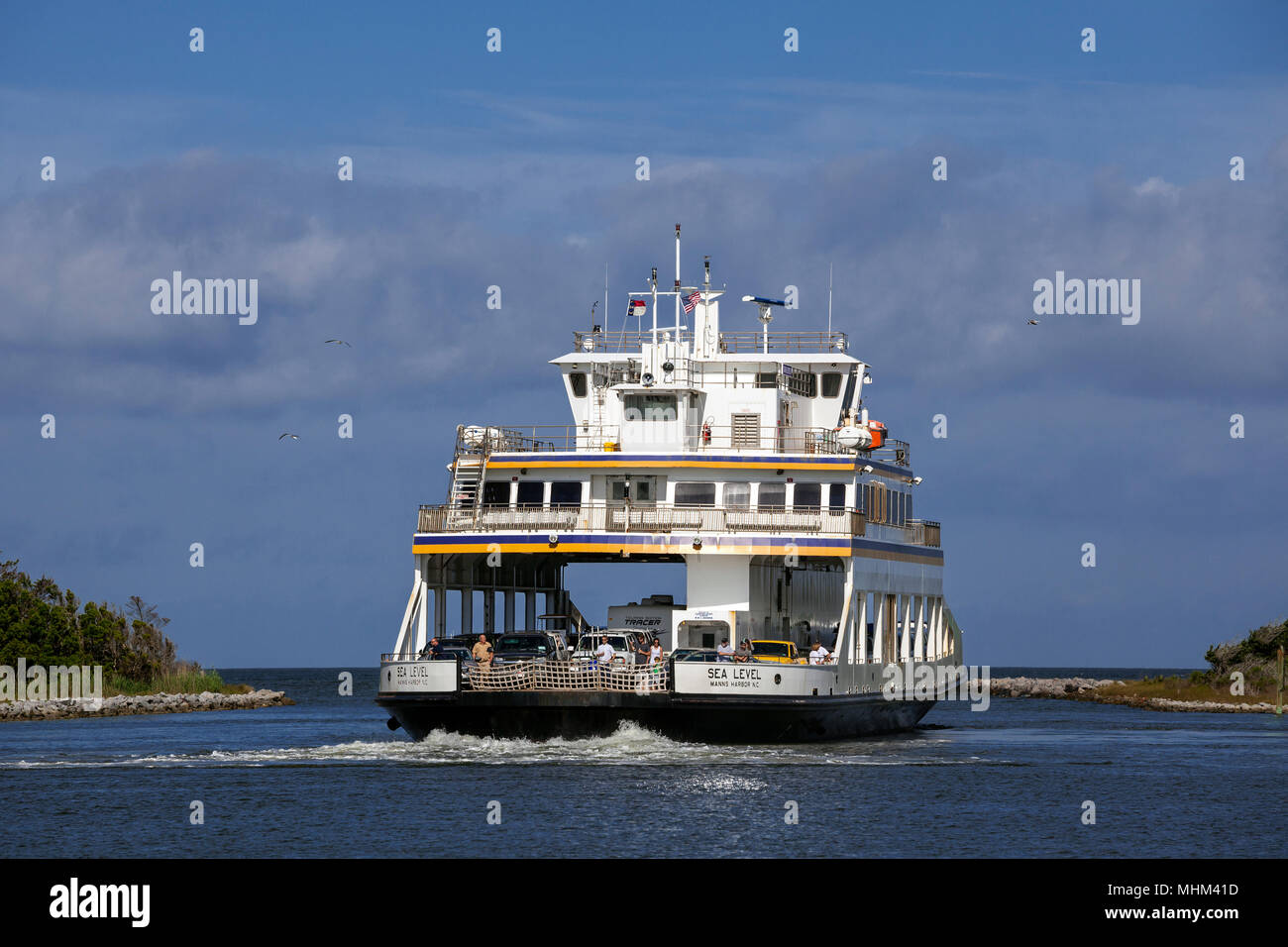 NC01580-00...NORTH CAROLINA - Ferry boat Sea Level leaving Silver Lake Harbor in the town of Ocracoke on Ocracoke Island part of the Outer Banks. Stock Photo