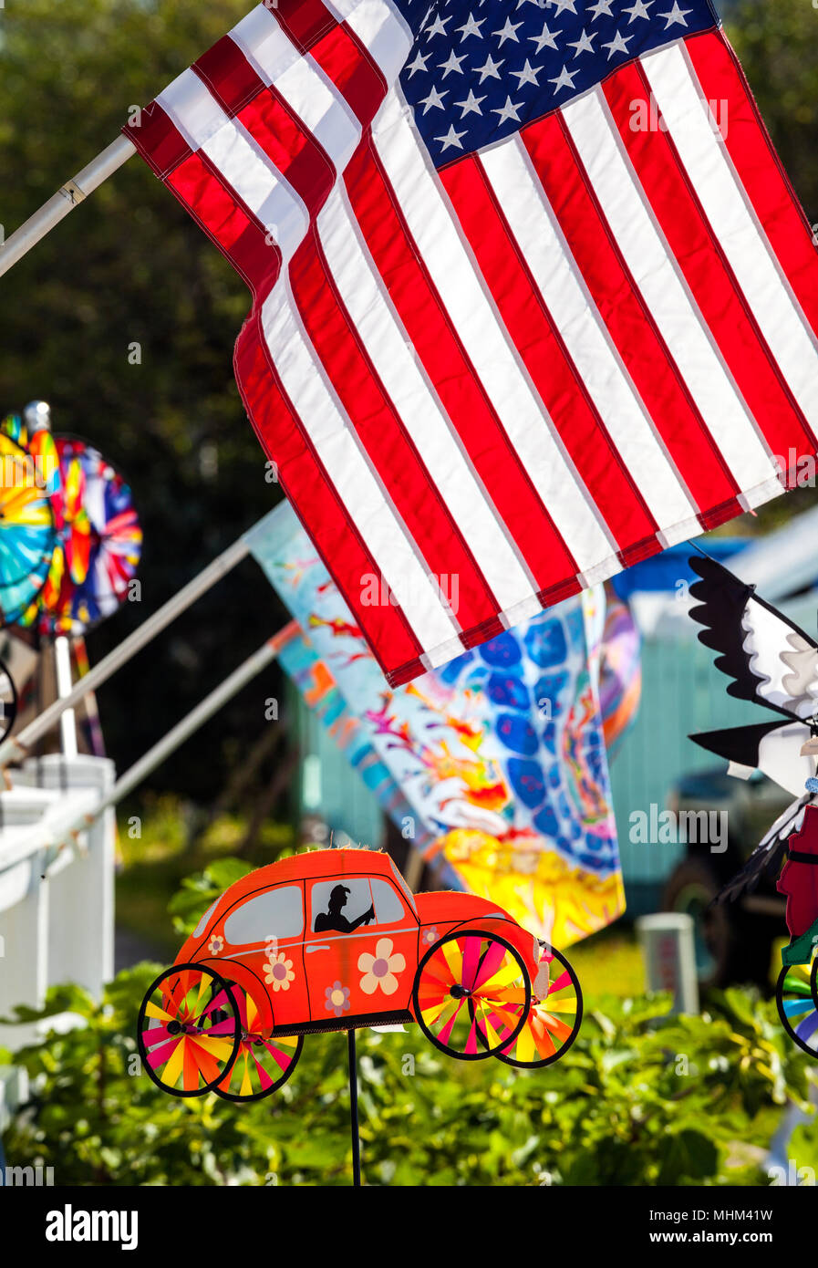NC01582-00...NORTH CAROLINA - Flags and wind spinners on Ocracoke Island part of the Outer Banks. - Stock Image