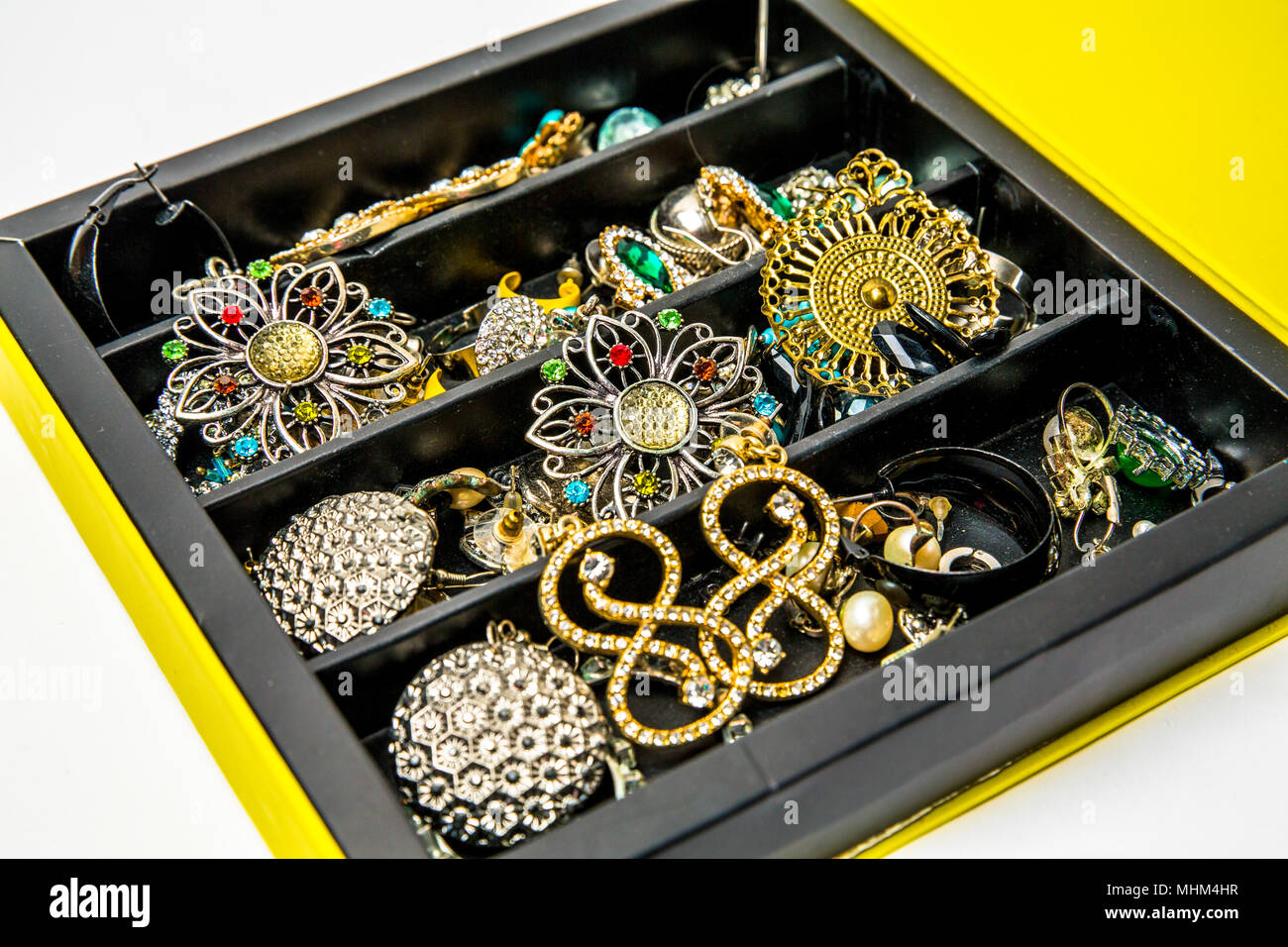 Jewel box with ornaments in white background - Stock Image