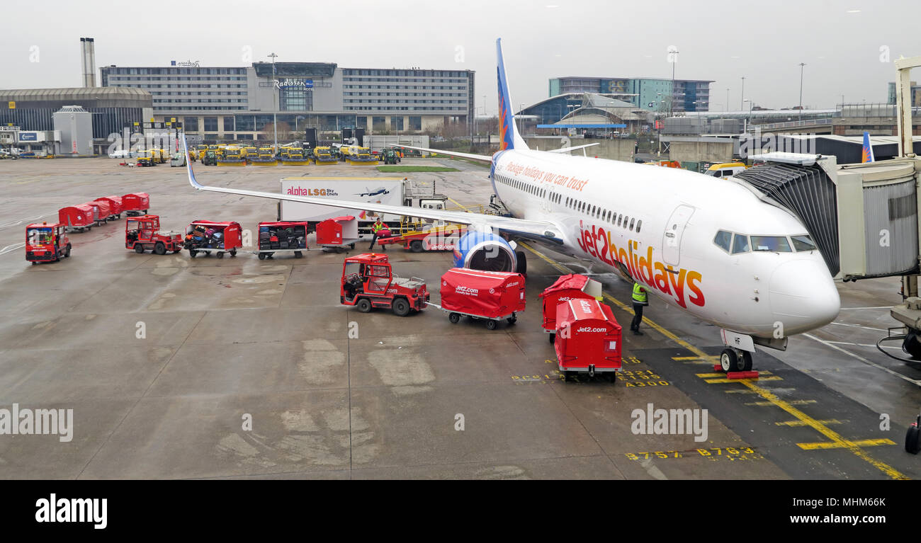 Jet2 holiday charter Flight, Manchester Airport, being loaded, North West England - Stock Image