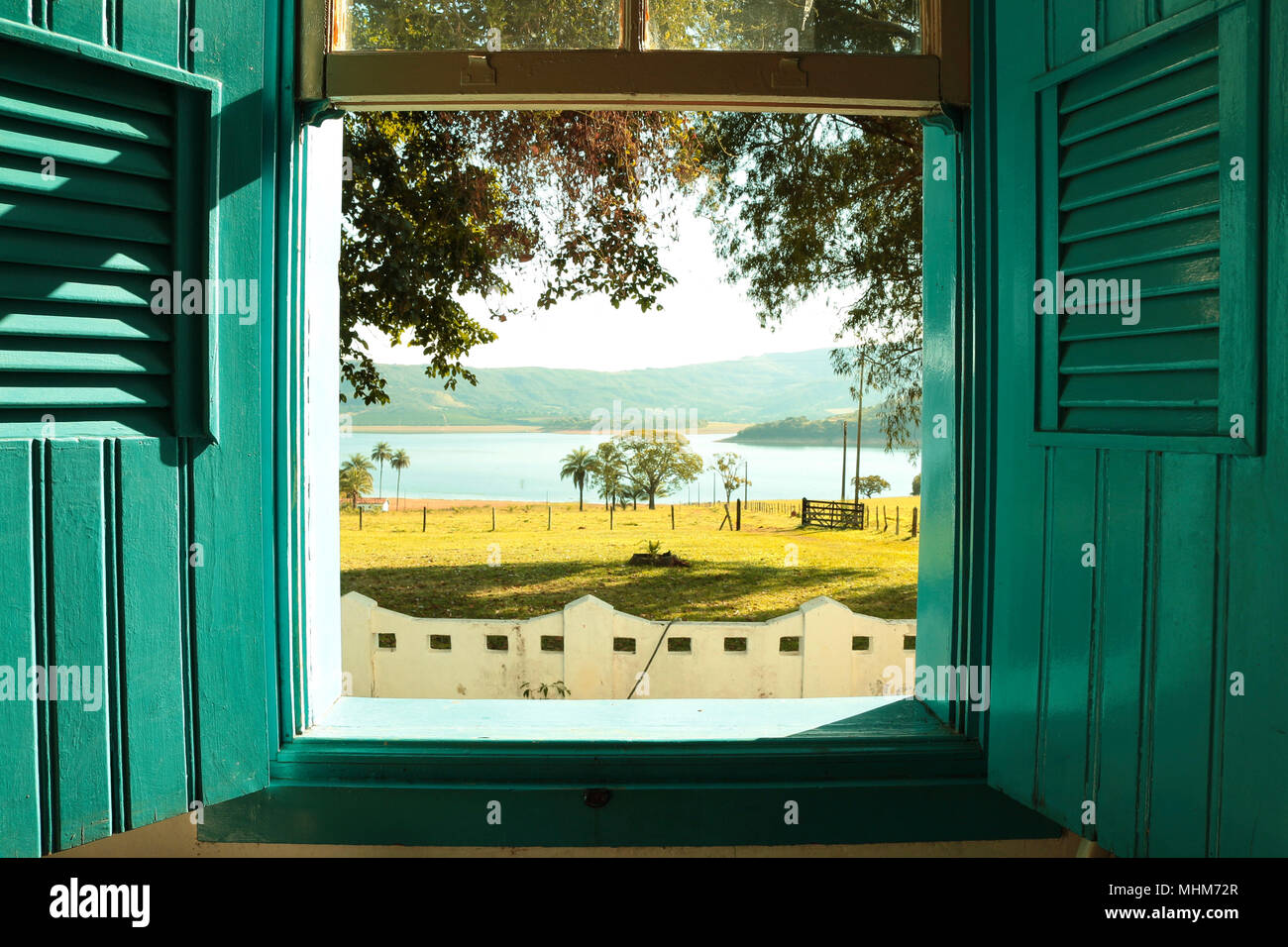 Old blue french window open to a sunny day - Stock Image