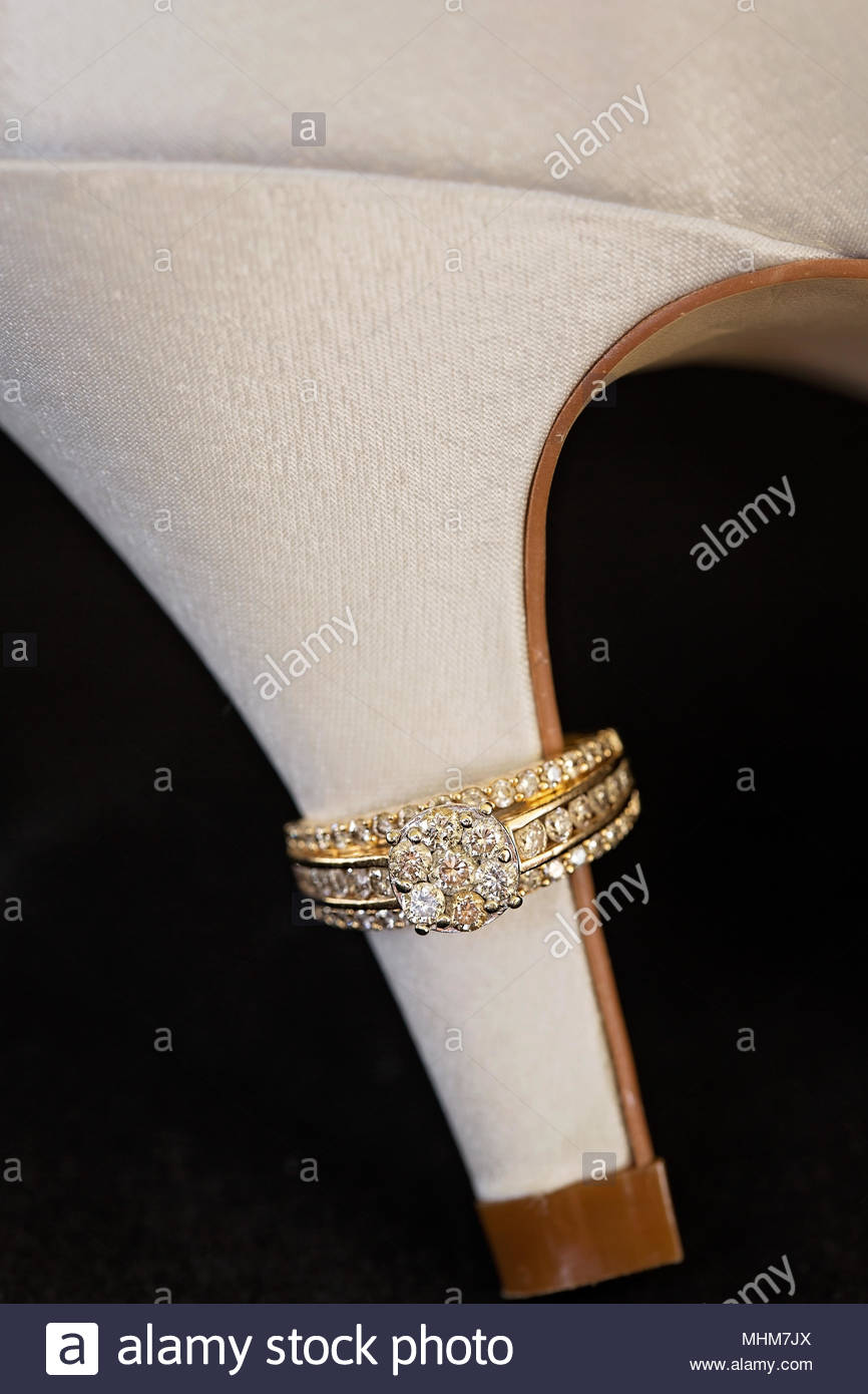 Diamond Engagement Ring On The Heel Of The Bride's Show - Stock Image