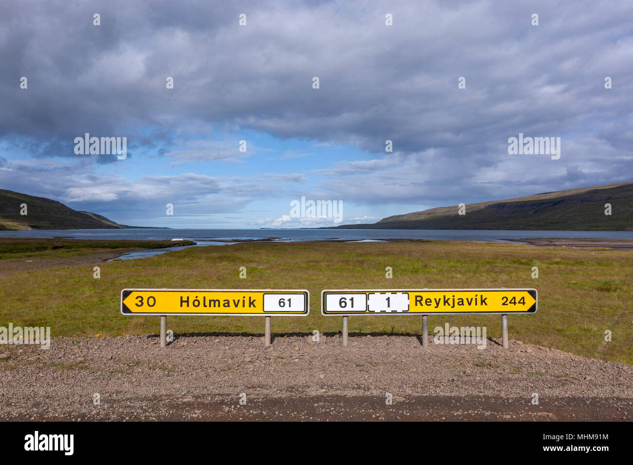 Distance road to Reykjavik and Holmavik yellow sign route 68, Westfjords Region, Iceland - Stock Image