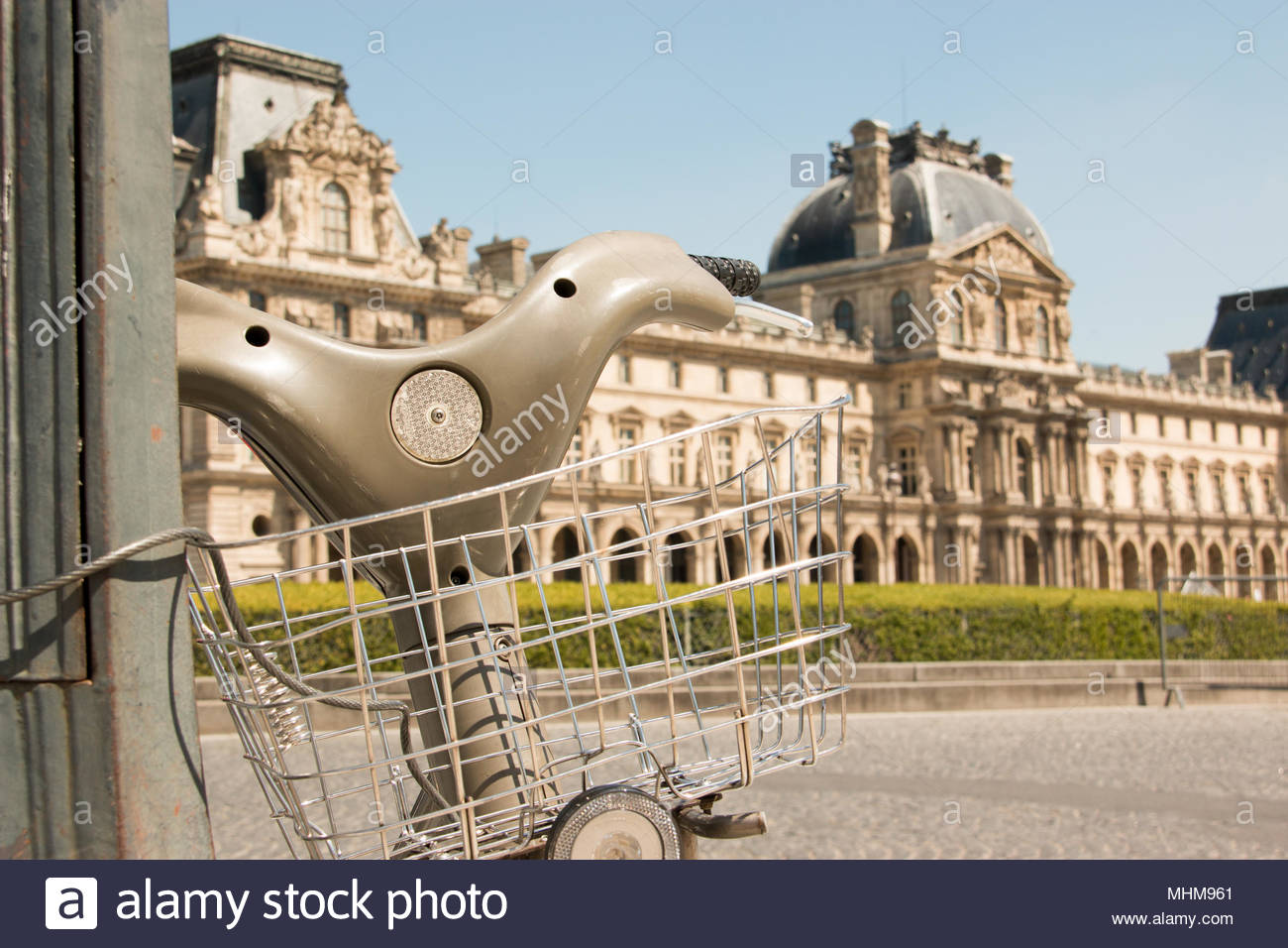 Visiting Paris by bicycle for hire, May 9, 2017. Bike and the Louvre museum. Stock Photo