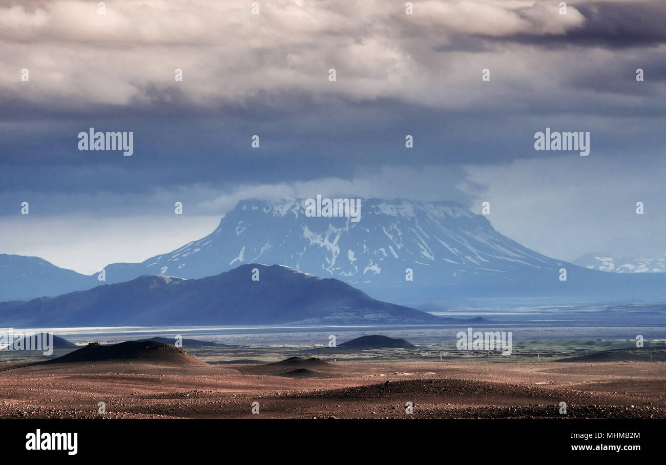Beautiful landscape of mountain in Iceland with volcano in the background - Stock Image