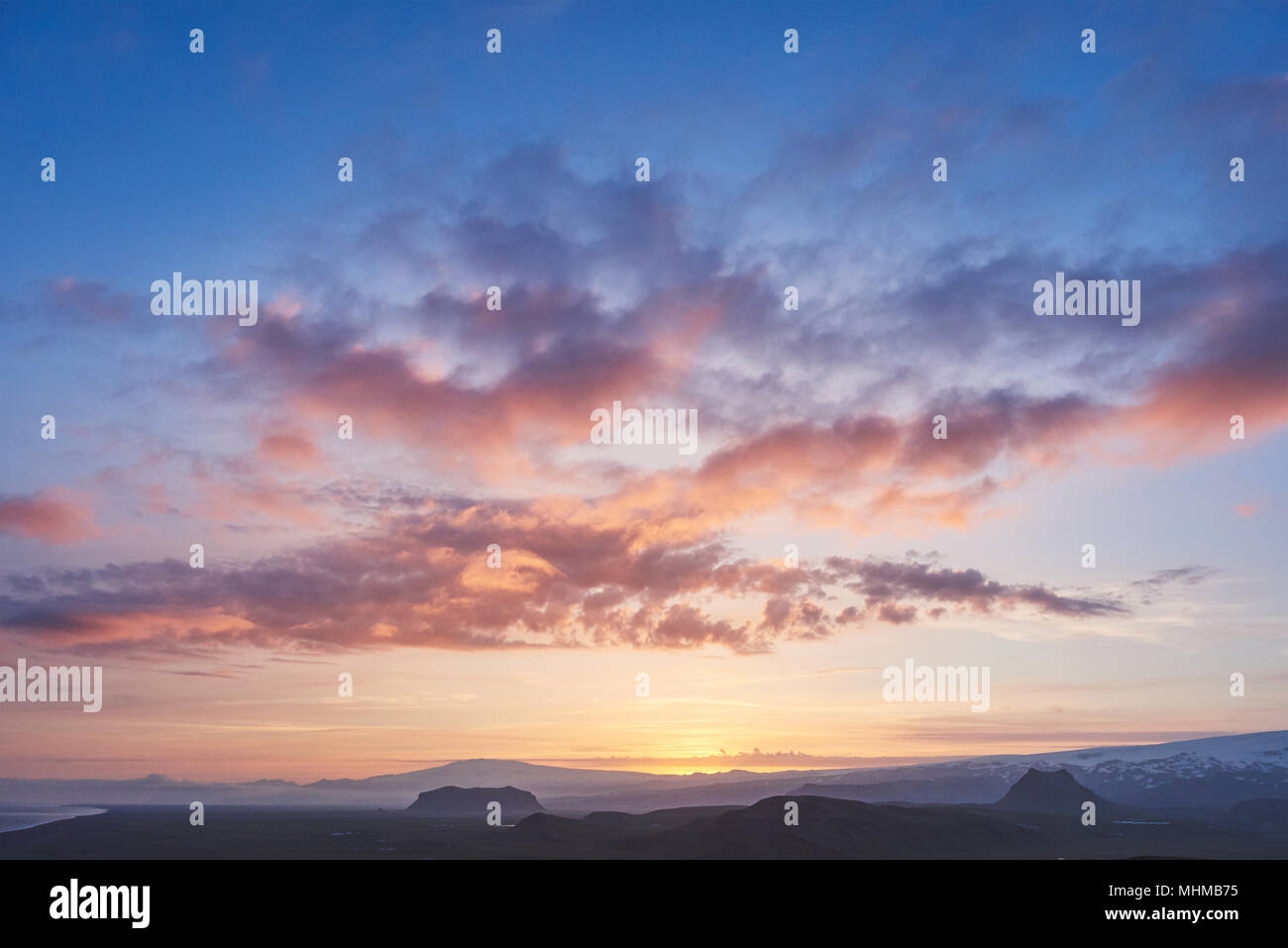 Majestic mountains landscape under morning sky with clouds Stock Photo