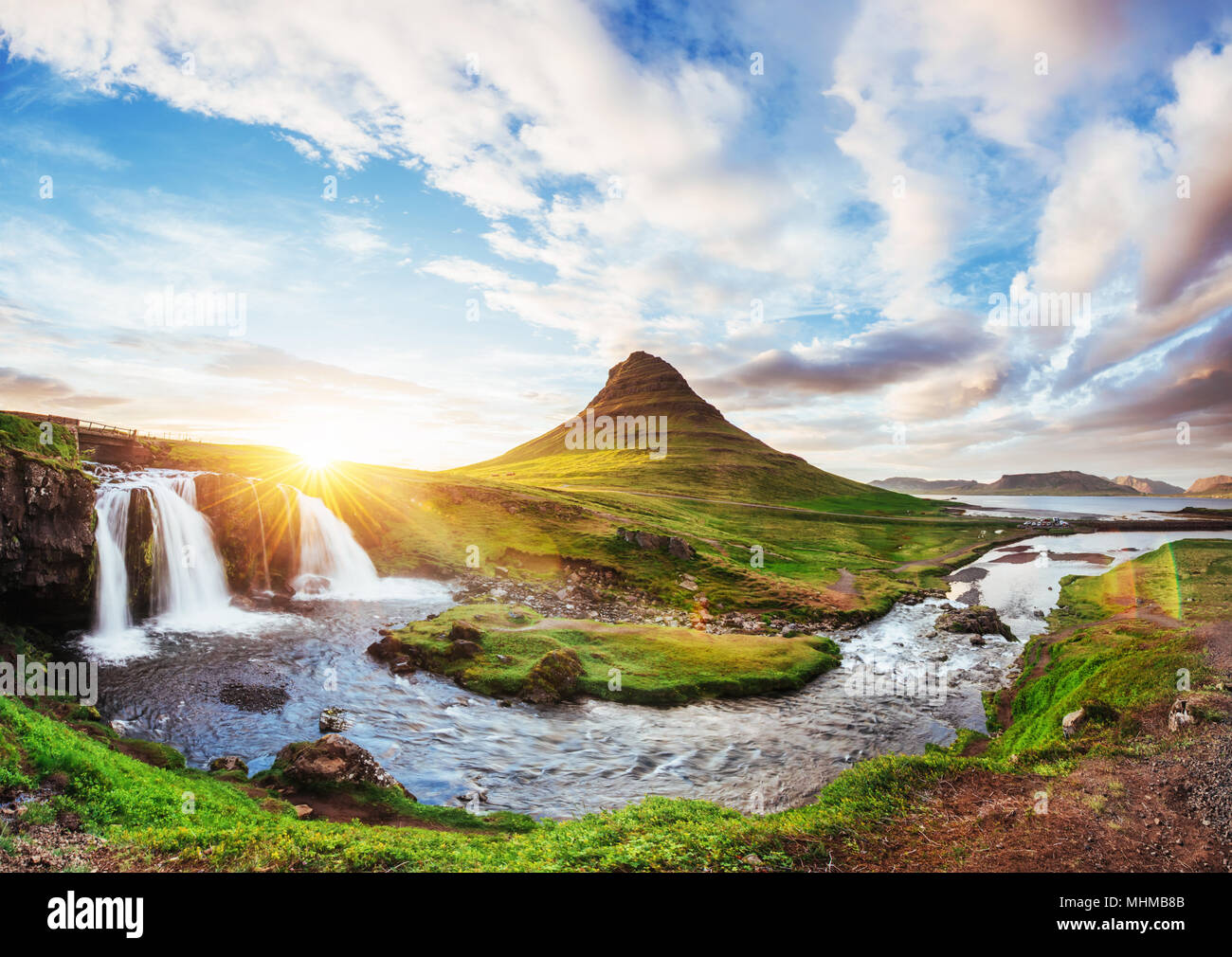 The picturesque sunset over landscapes and waterfalls. Kirkjufell mountain, Iceland - Stock Image