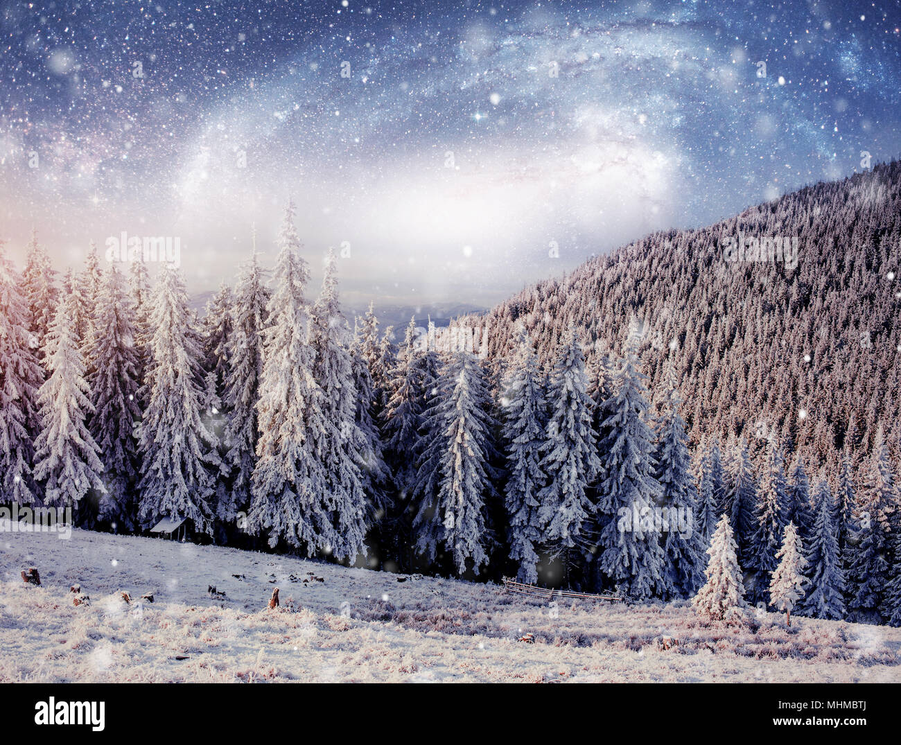 starry sky in winter snowy night. fantastic milky way in the New Year's Eve. Courtesy of NASA. In anticipation of the holiday. Dramatic scene. Carpathian. Ukraine - Stock Image