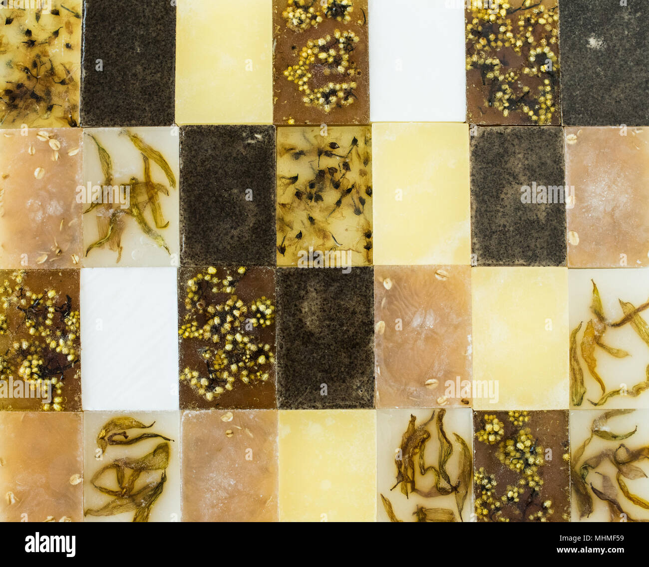 Yellow and brown assorted different handmade soap bars abstract Stock Photo