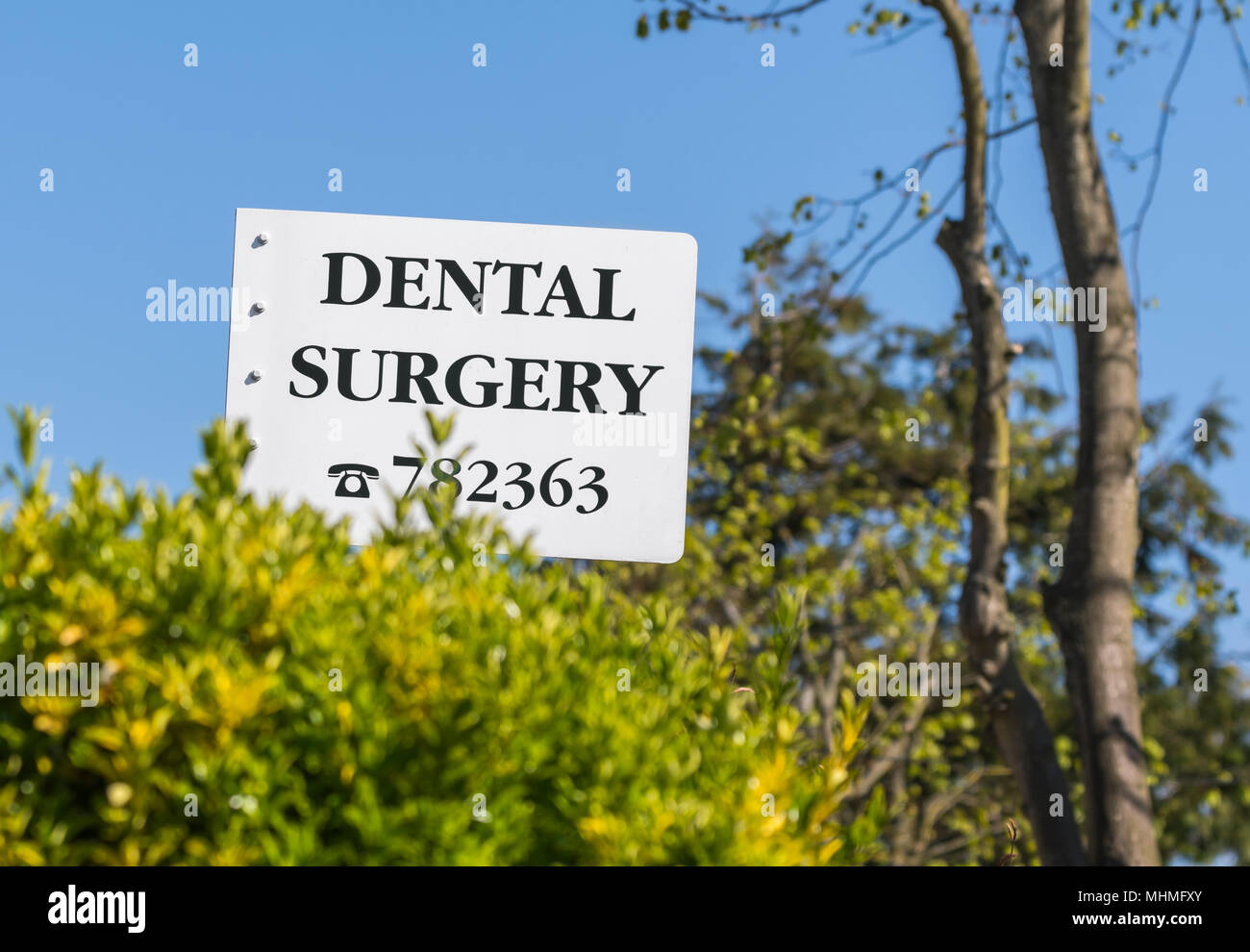 Dental surgery sign in the UK. Dentist surgery. Dentists practice. - Stock Image