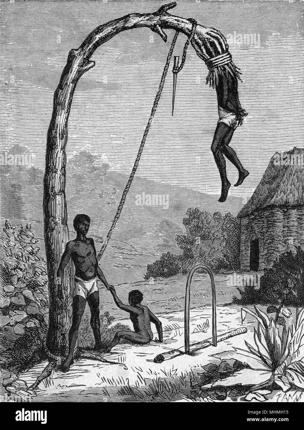 Dahomey : a parricide is tied to a tree and left to die, a slow and uncomfortable process       Date: 1905 - Stock Image