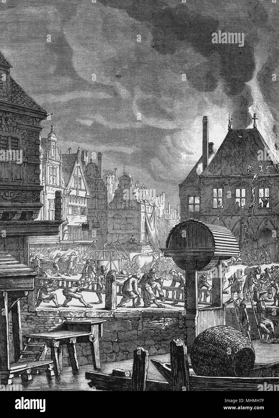 Fire-fighters attempt to extinguish a fire in the centre of Amsterdam      Date: 17th Century - Stock Image