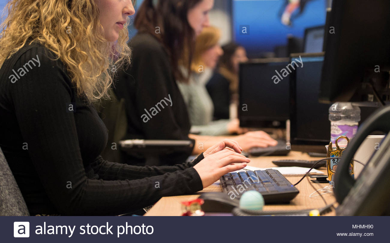 "Embargoed to 0001 Thursday May 03 File photo dated 07/01/16 of office workers at their desks. Transport and logistics, the TUC have said that one in five low-paid workers are ""stuck"" in their jobs for a decade. - Stock Image"