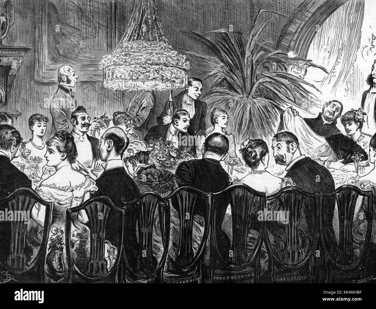 Guests indulge in food and conversation at a good-natured dinner party       Date: 1885 - Stock Image