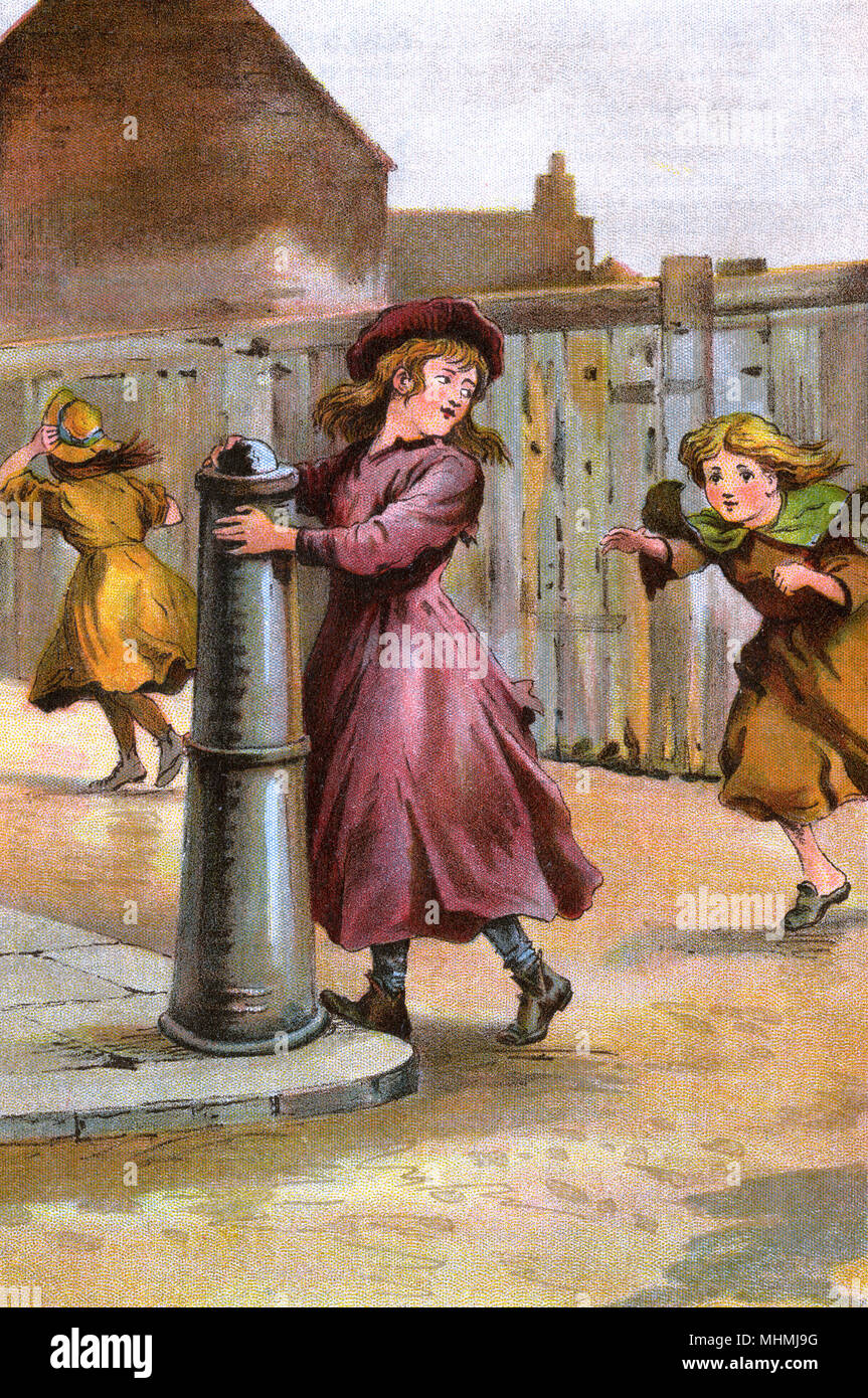 Girls playing 'touch' in the street - the aim is to touch the bollard before you yourself are touched      Date: 1897 - Stock Image
