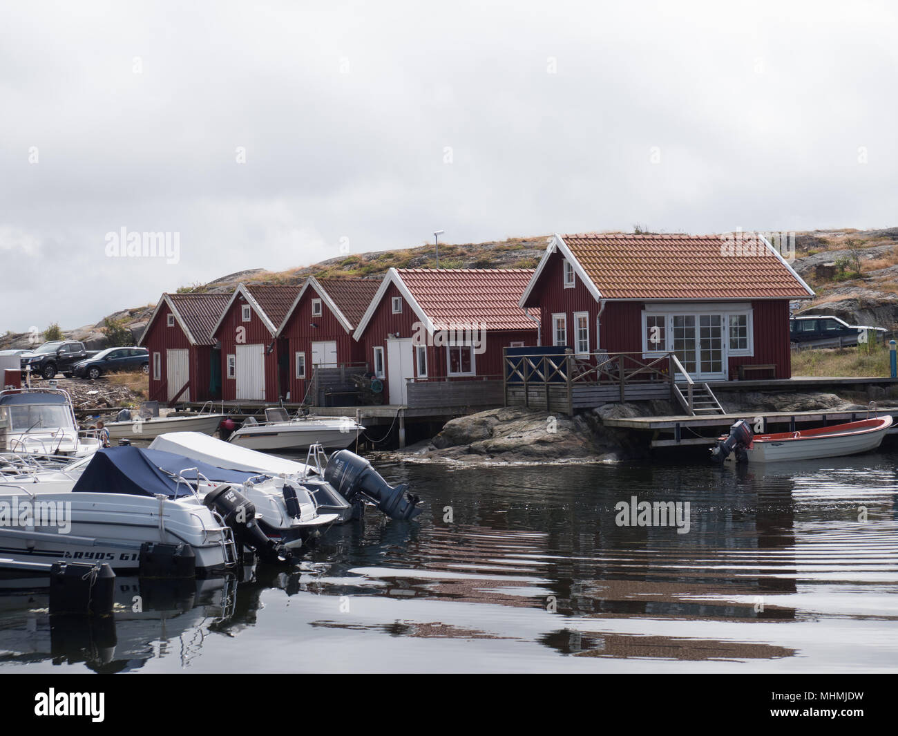 Fish cattages in Smögen, the swedish west coast. An overcast day. - Stock Image