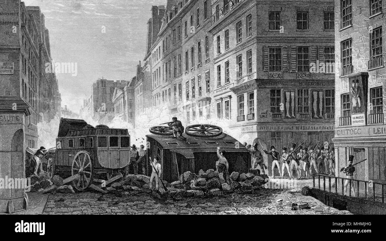 Parisian rebels defend barricades at the Rue St Honore, on the corner of Rue du Coq      Date: 1830 - Stock Image