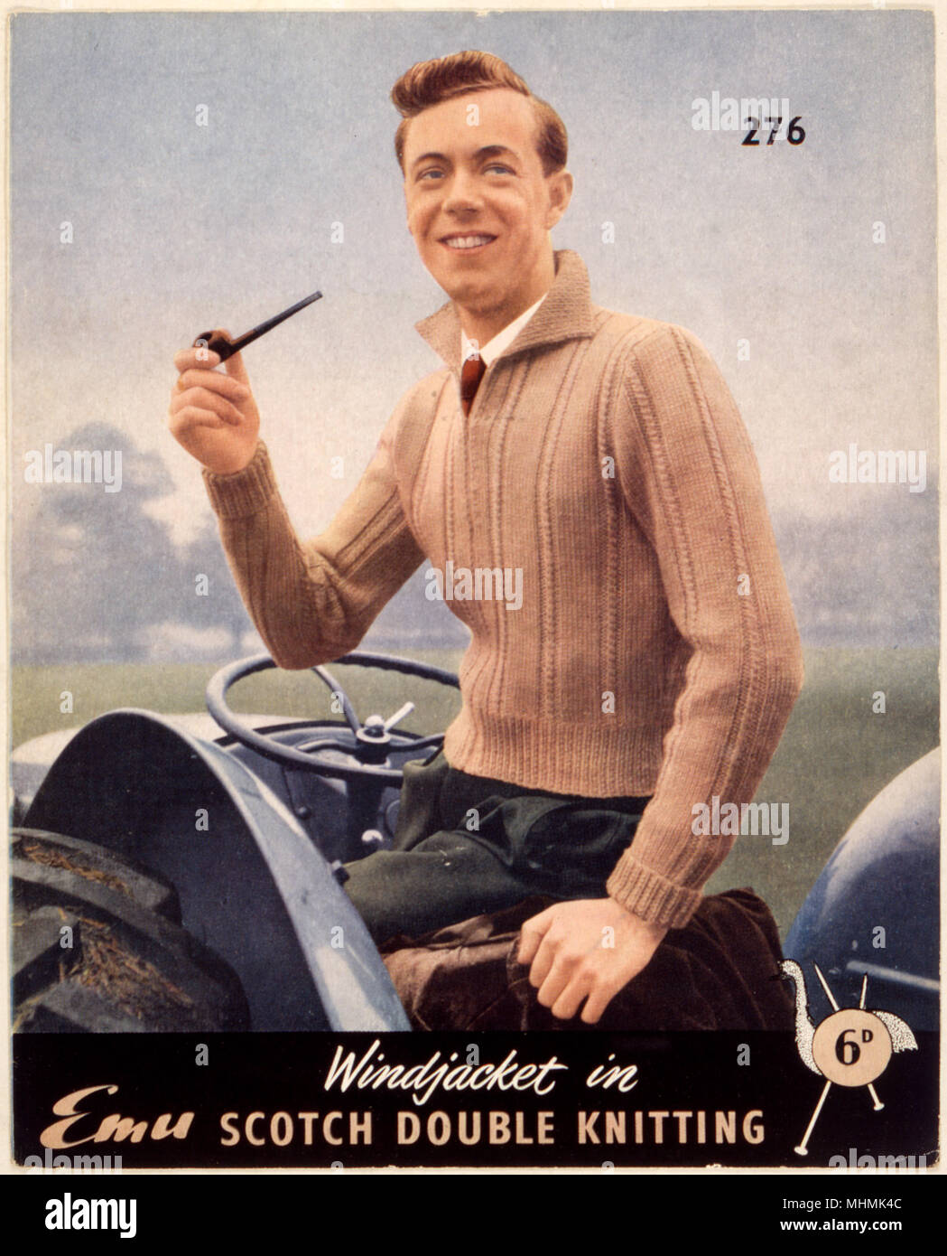 A lovely beige, knitted 'windjacket' just the thing for smoking a pipe in while out ploughing the fields! Worn with green trousers & red tie, it's smart, yet practical.     Date: 1950s - Stock Image