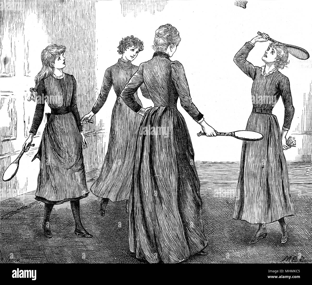 Four ladies enjoy a game of battledore and shuttlecock indoors.       Date: 1891 - Stock Image