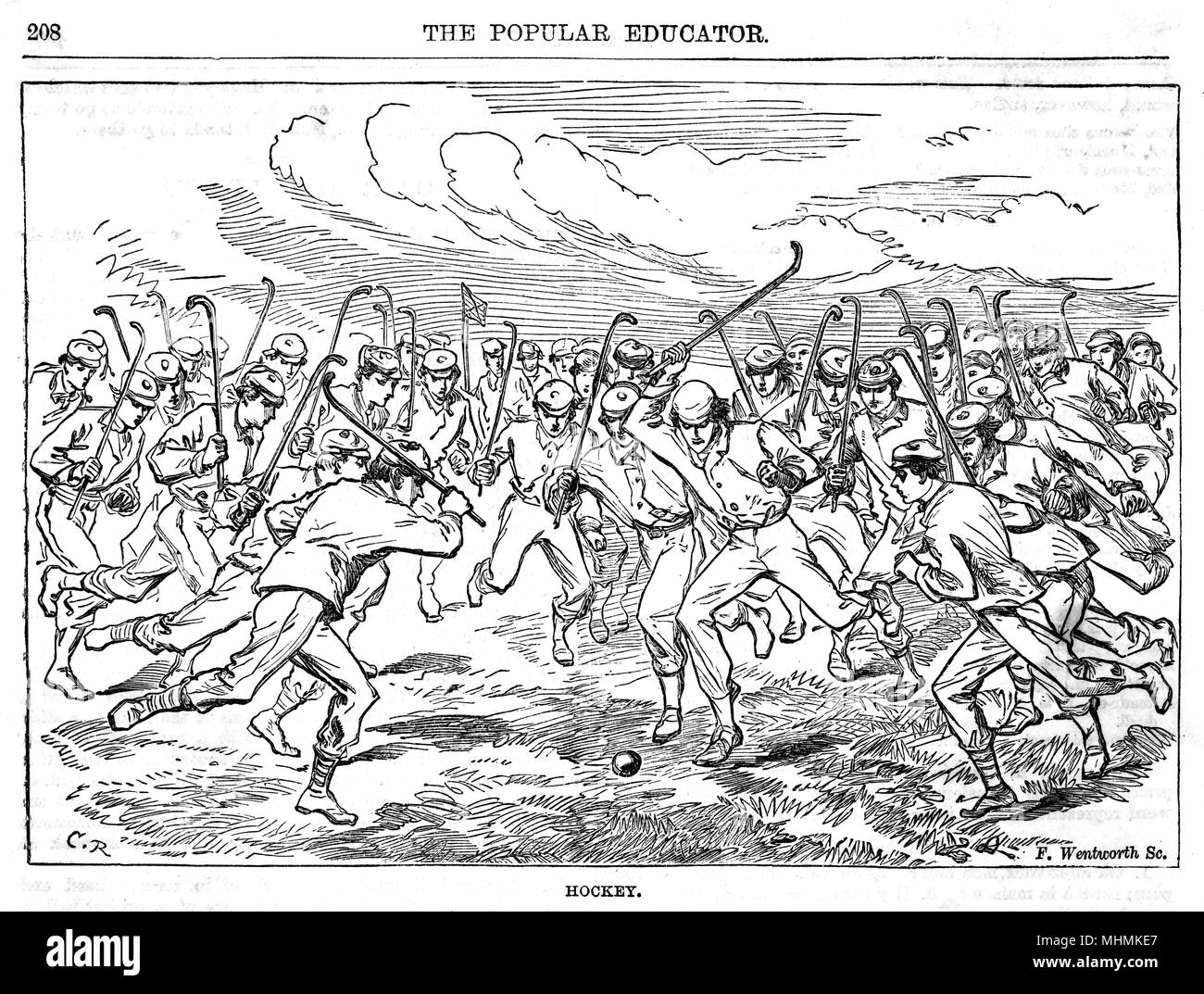 A crowd of players charge towards the ball during a game of hockey.       Date: circa 1860 Stock Photo