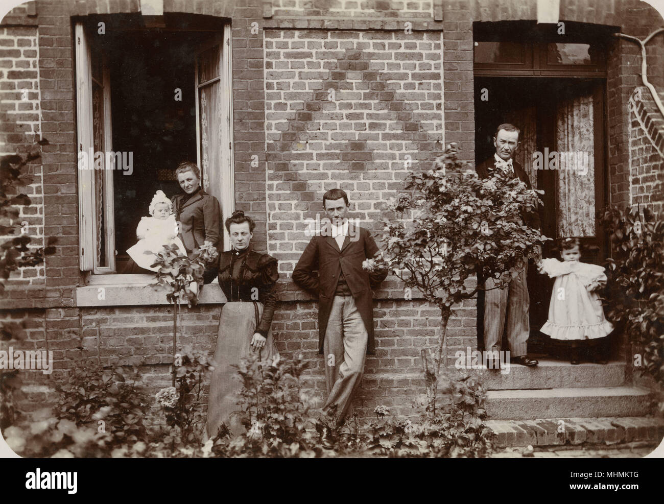 A French family at their home in Neufchatel, near Dieppe      Date: 1899 - Stock Image