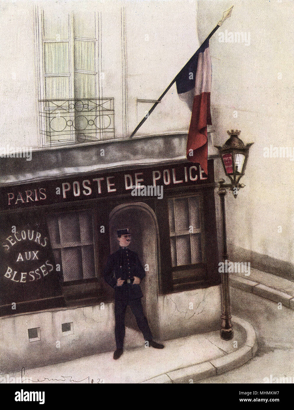 A French policeman stands outside his rural gendarmerie.  He stands waiting for some action with his thumbs tucked into his belt.      Date: 1930 - Stock Image