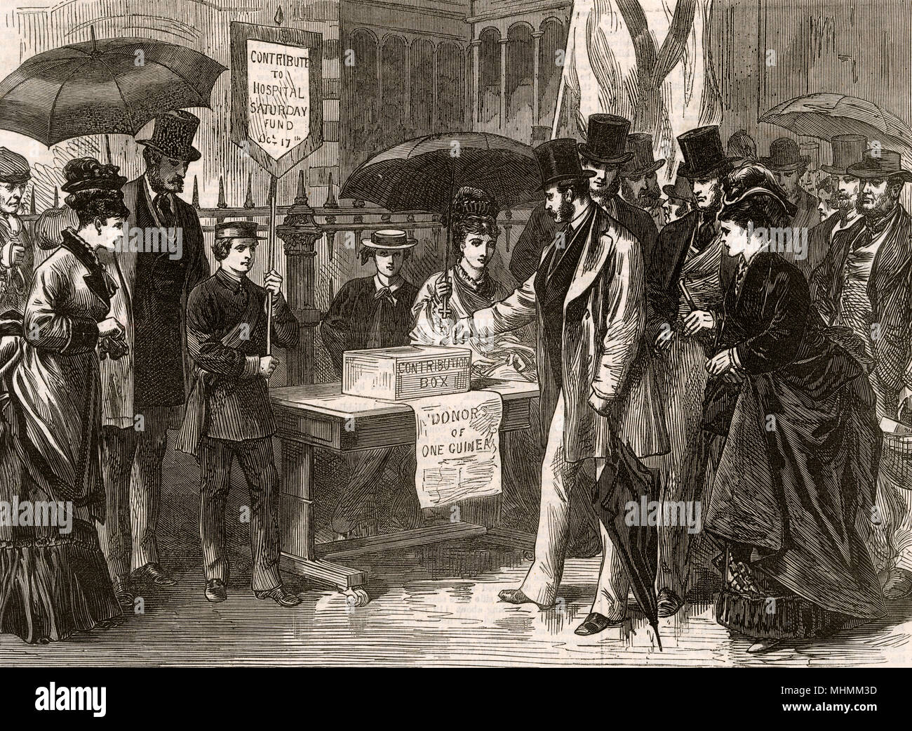 In the streets of London passers-by contribute to 'Hospital Saturday', putting their guineas in the collection box.     Date: 1874 - Stock Image