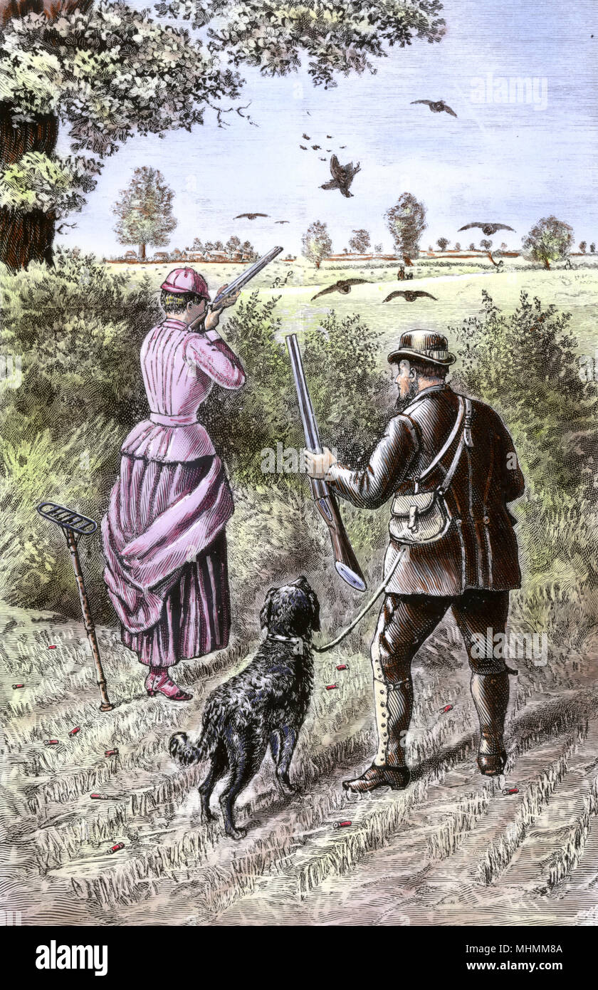 A lady and her loader, with a dog to retrieve her kill, go after partridge in Norfolk.  Note the seat-stick on which she can rest her bum while waiting for the birds to show.      Date: 1888 - Stock Image
