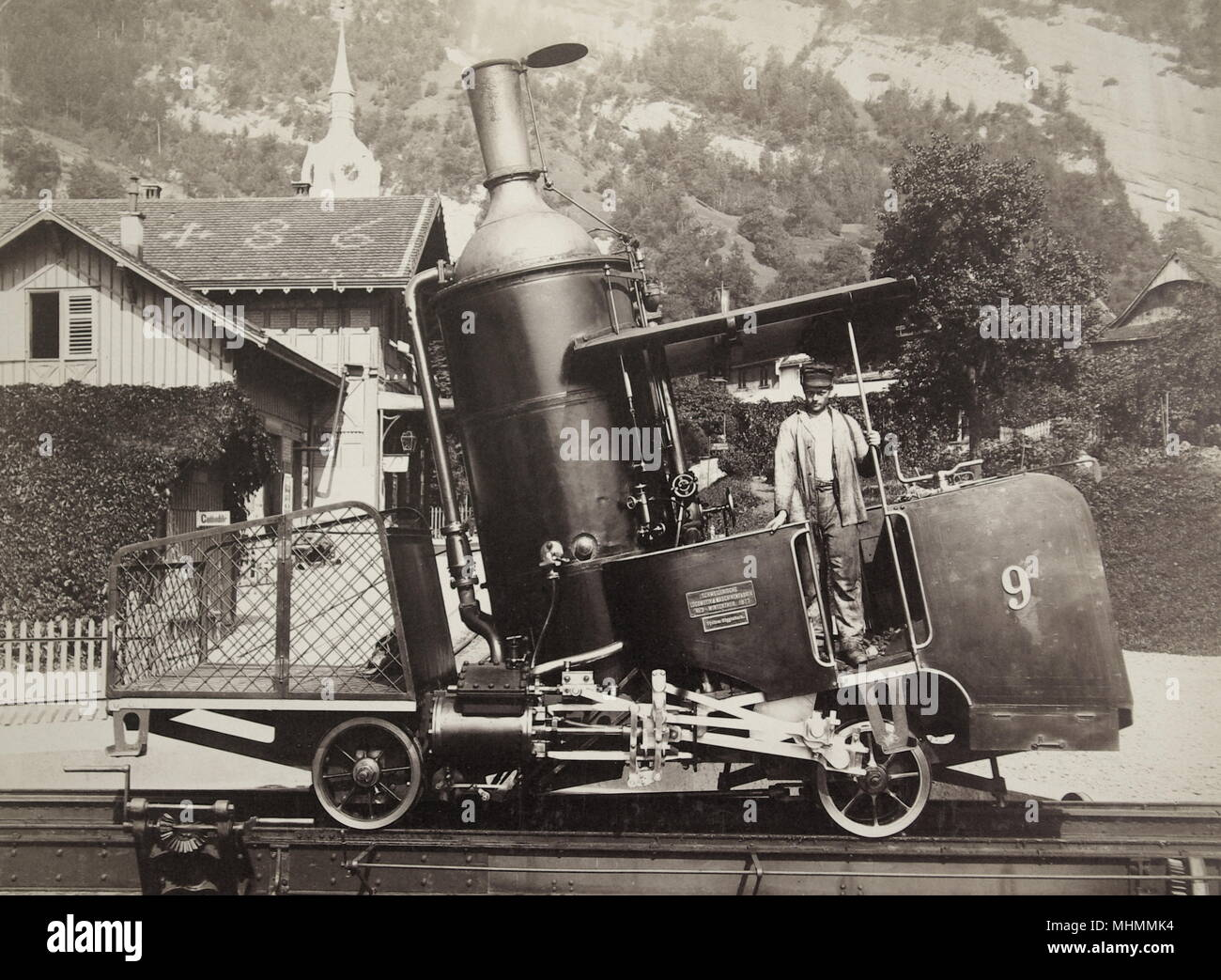 A Swiss narrow gauge rack and pinion railway engine, built circa 1900, with driver.  From the archives of the Gloucester Coach and Wagon Works in the Gloucester Record Office.      Date: circa 1900 - Stock Image