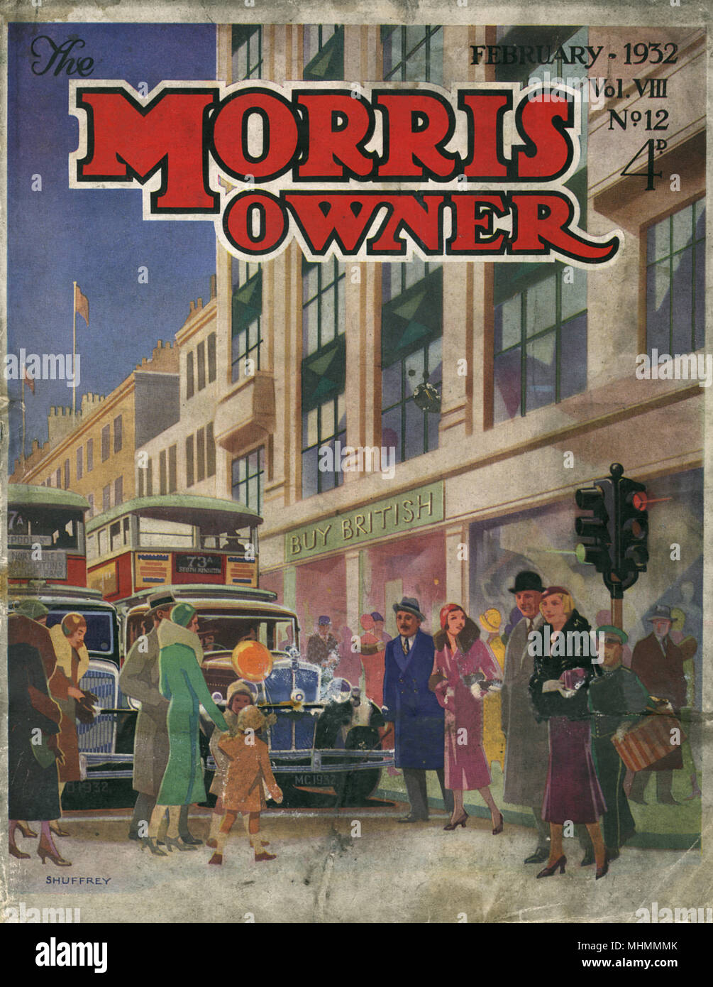 Front cover of The Morris Owner magazine from 1932, with a lovely illustration featuring a busy road on a high street populated with shoppers.  As cars and buses stop at traffic lights and wait for pedestrians to cross, a modern looking department store in the background exhorts the public to 'Buy British.'     Date: 1932 - Stock Image