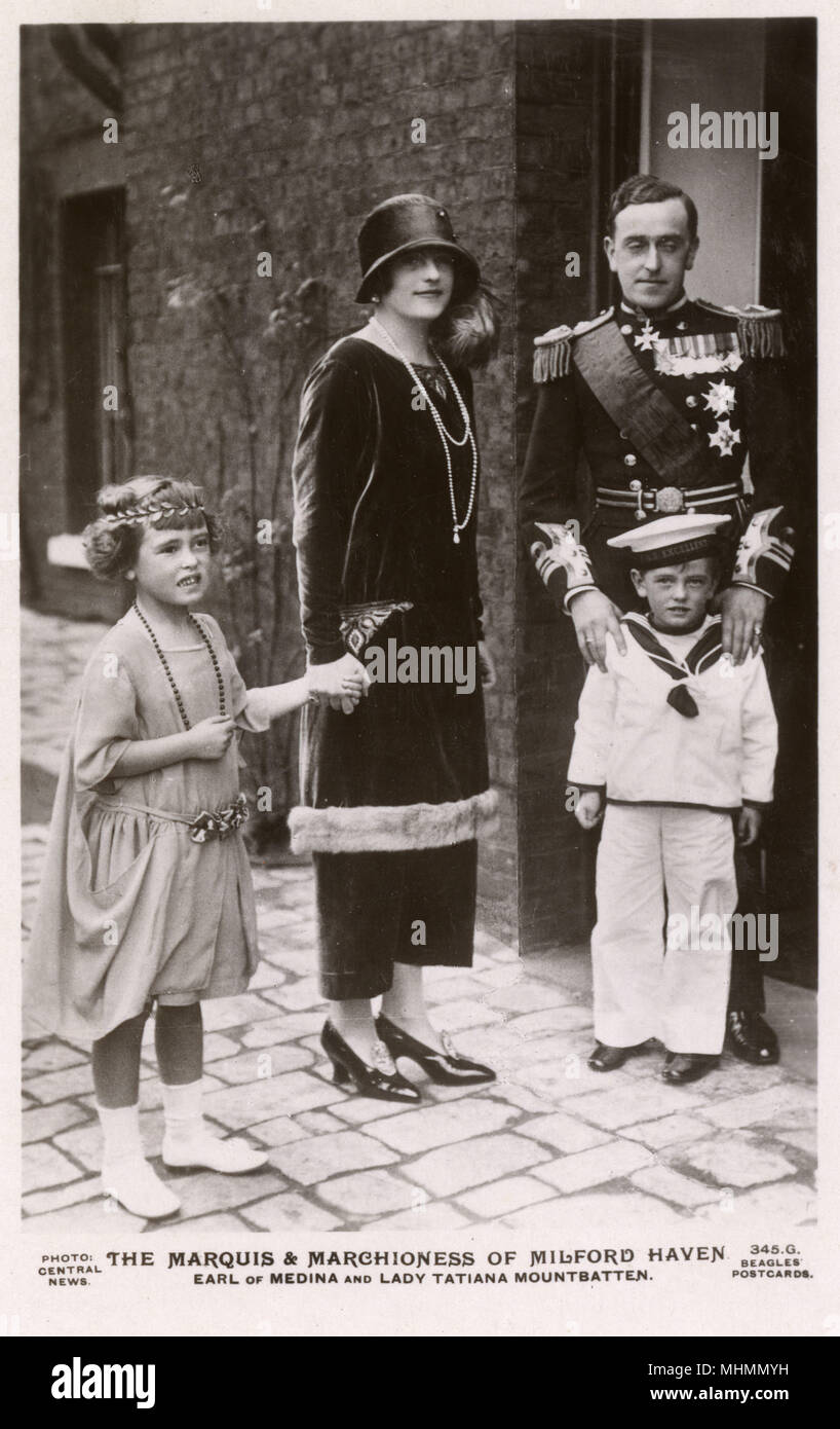 The Marquis and Marchioness of Milford Haven at the wedding of the Marquis' sister Lady Louise Mountbatten to King Gustav Adolf of Sweden in November 1923.  They are  accompanied by their children, David Mountbatten, Earl of Medina and Lady Tatiana Mountbatten.     Date: c.1923 - Stock Image