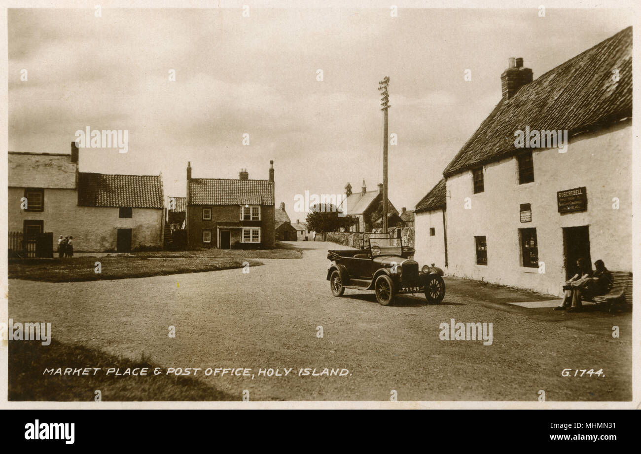 The Market place and post office on the Holy Island of Lindisfarne.     Date: c.1930s - Stock Image