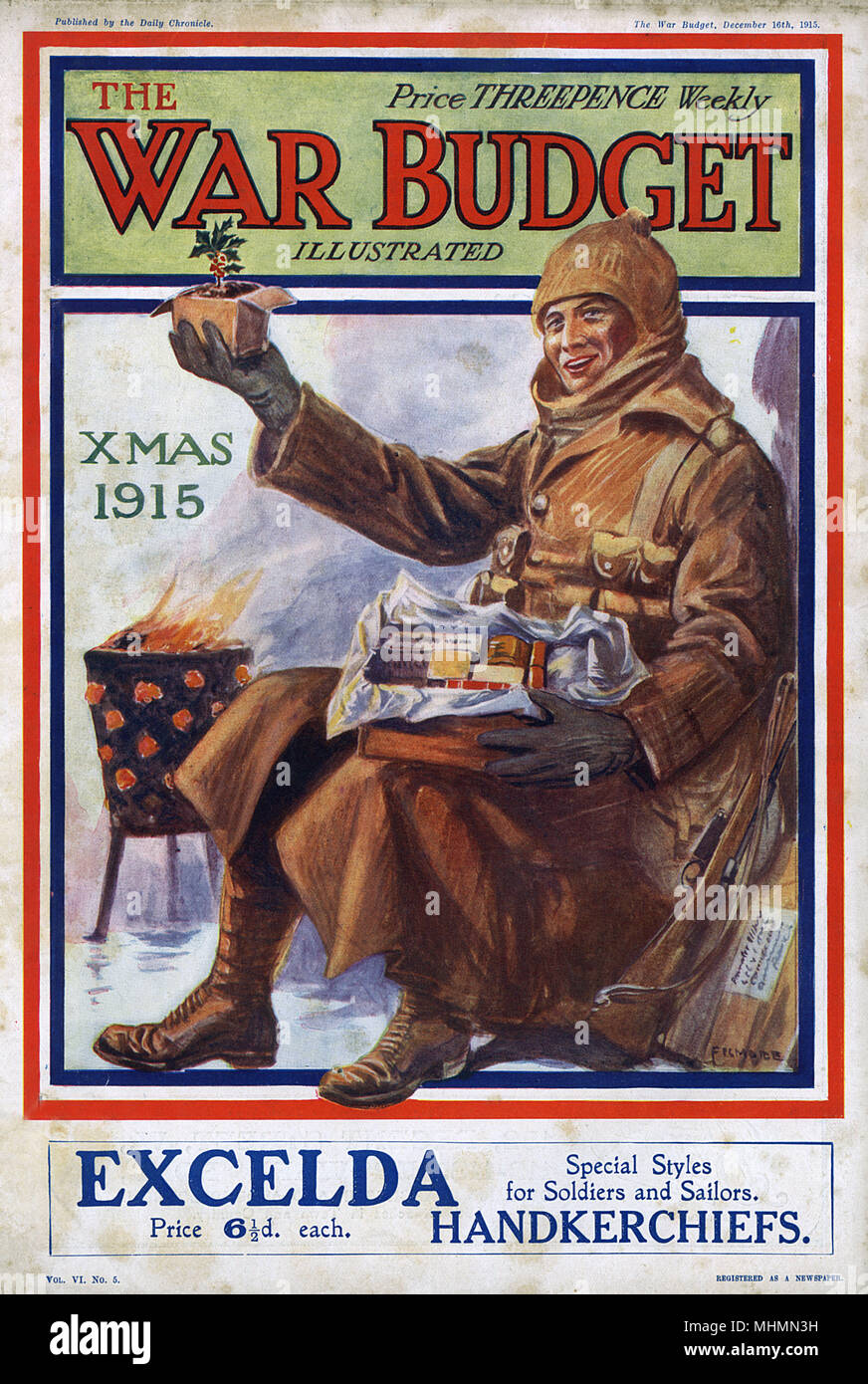 Front cover of The War Budget, Christmas 1915, showing a British soldier sitting in a trench next to a brazier as he opens a parcel of Christmas food sent from home.       Date: 1915 - Stock Image