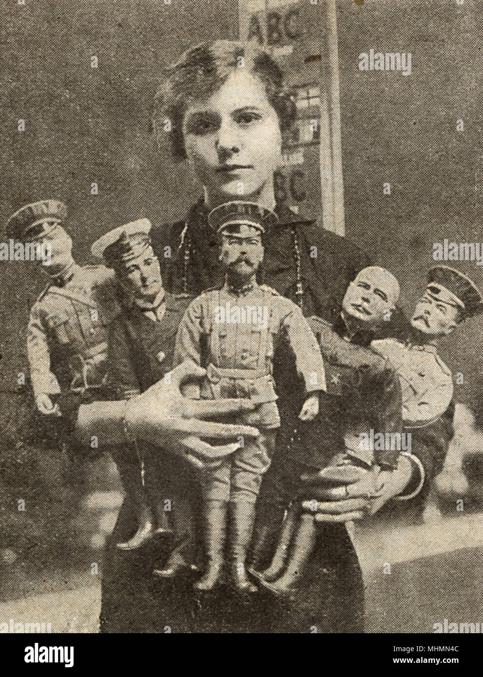 An female worker posed with war dolls representing the King, Lord Kitchener, Sir John French, Sir John Jellicoe and General Joffre.  A selection of British-made toys during the First World War.  Before the war, Germany had been the premier supplier of toys to Britain, but British industry quickly adapted, employing many women in the process.       Date: 1915 - Stock Image