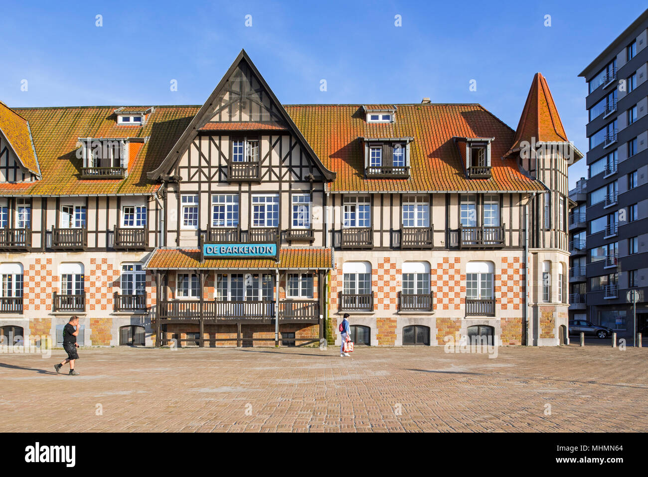 De Barkentijn, corner house in Norman style, now holiday center in the seaside resort Nieuwpoort / Nieuport, West Flanders, Belgium - Stock Image