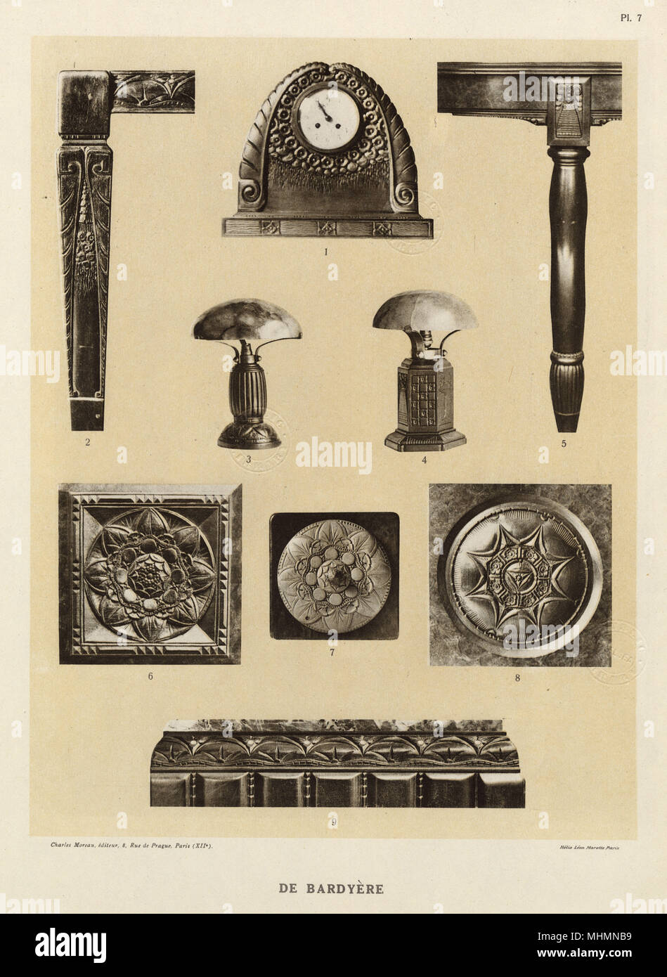 Bas-relief carvings by Georges de Bardyere (1883-1941) including a clock surround, a table leg, two lamps and a variety of artistic details in decorative style.     Date: circa 1910s Stock Photo