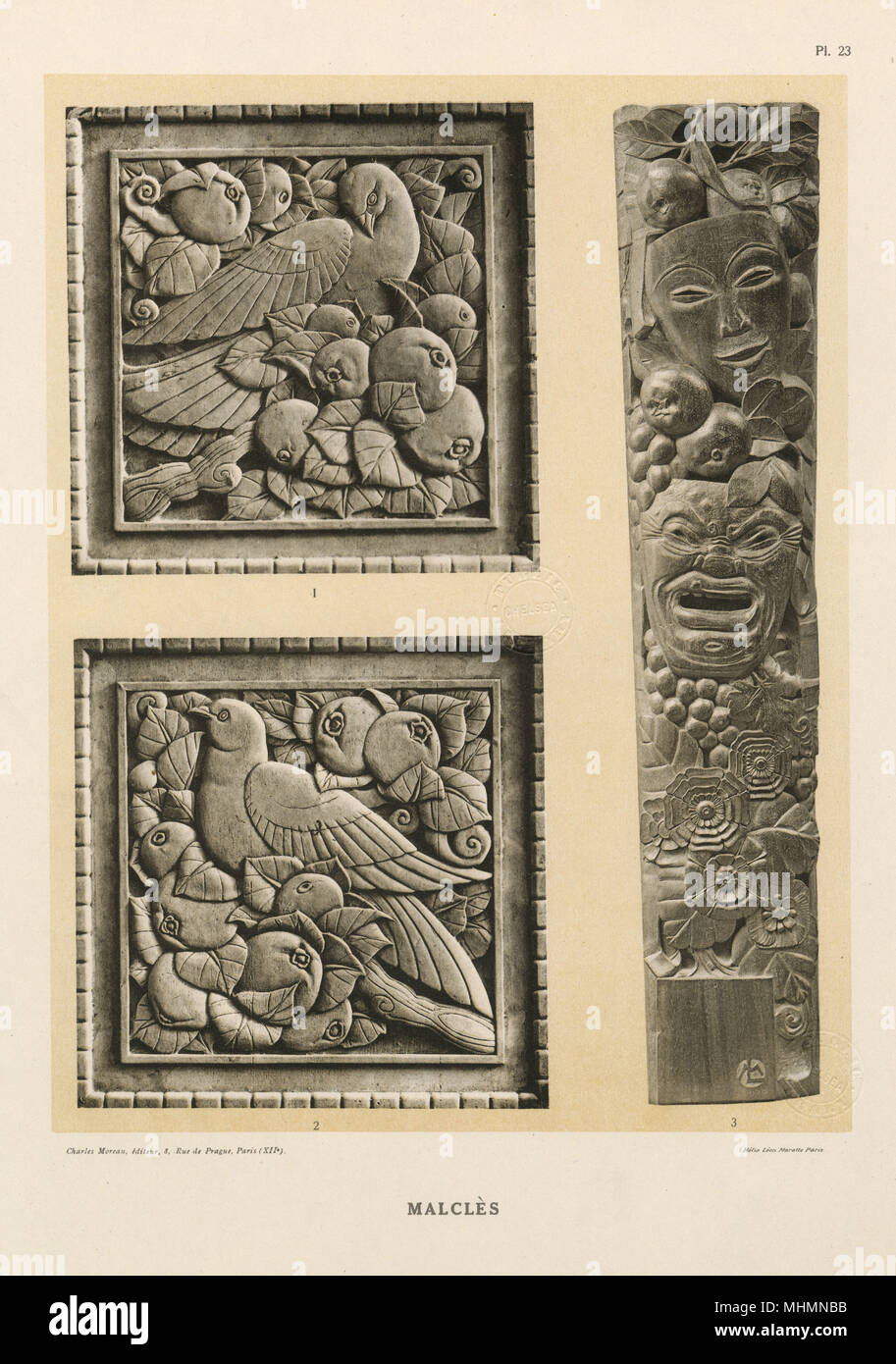 Bas-relief carvings by Laurent Malcles (dates unknown) - two carved panels for a dining room featuring birds in fruit trees and a tall carving of masks and fruit.     Date: circa 1920s - Stock Image