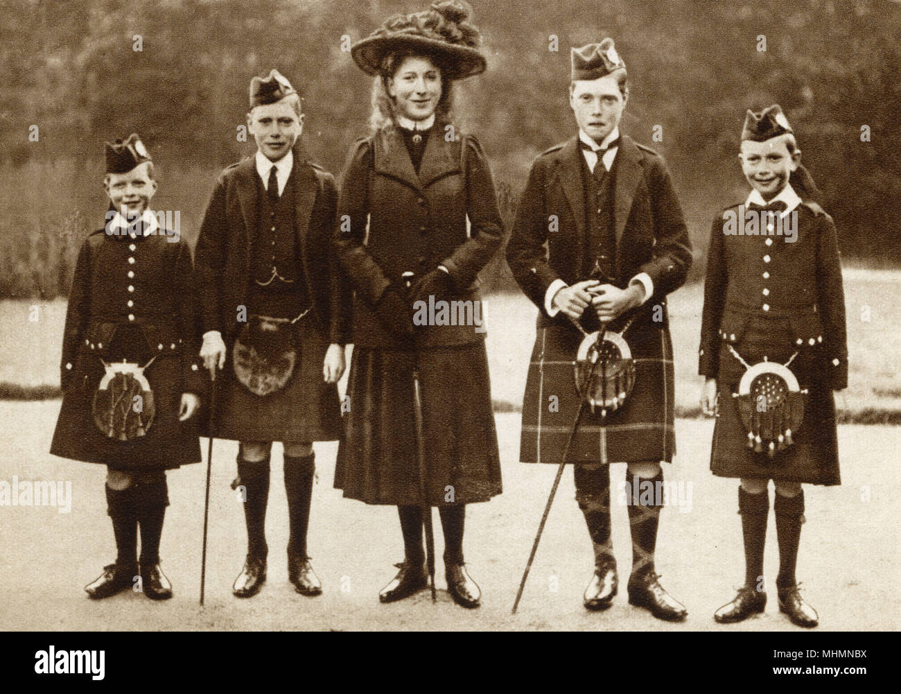 Five of the children of King George V: (from left) Prince George, Prince Albert (later King George VI) Princess Mary, Prince Edward - Prince of Wales (later King Edward VIII), and Prince Henry, Duke of Gloucester. Photograph likely to have been taken at the Royal residence of Balmoral in Scotland.     Date: 1911 Stock Photo