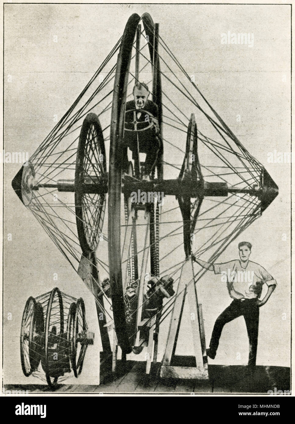 'A New Terror of the Road' - the quite remarkable invention of Professor E. J. Christie of marion Ohio - a huge Gyroscopic Wheel Unicycle, which the creator claimed would be able to hit speeds in excess of 400mph...!     Date: 1923 - Stock Image