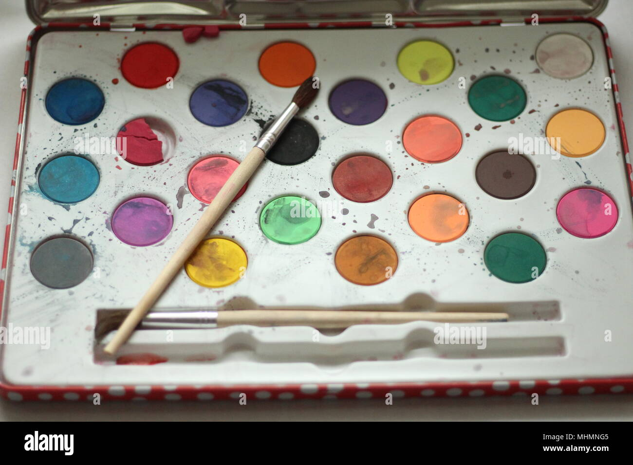 Children's watercolour paintbox and brush - Stock Image