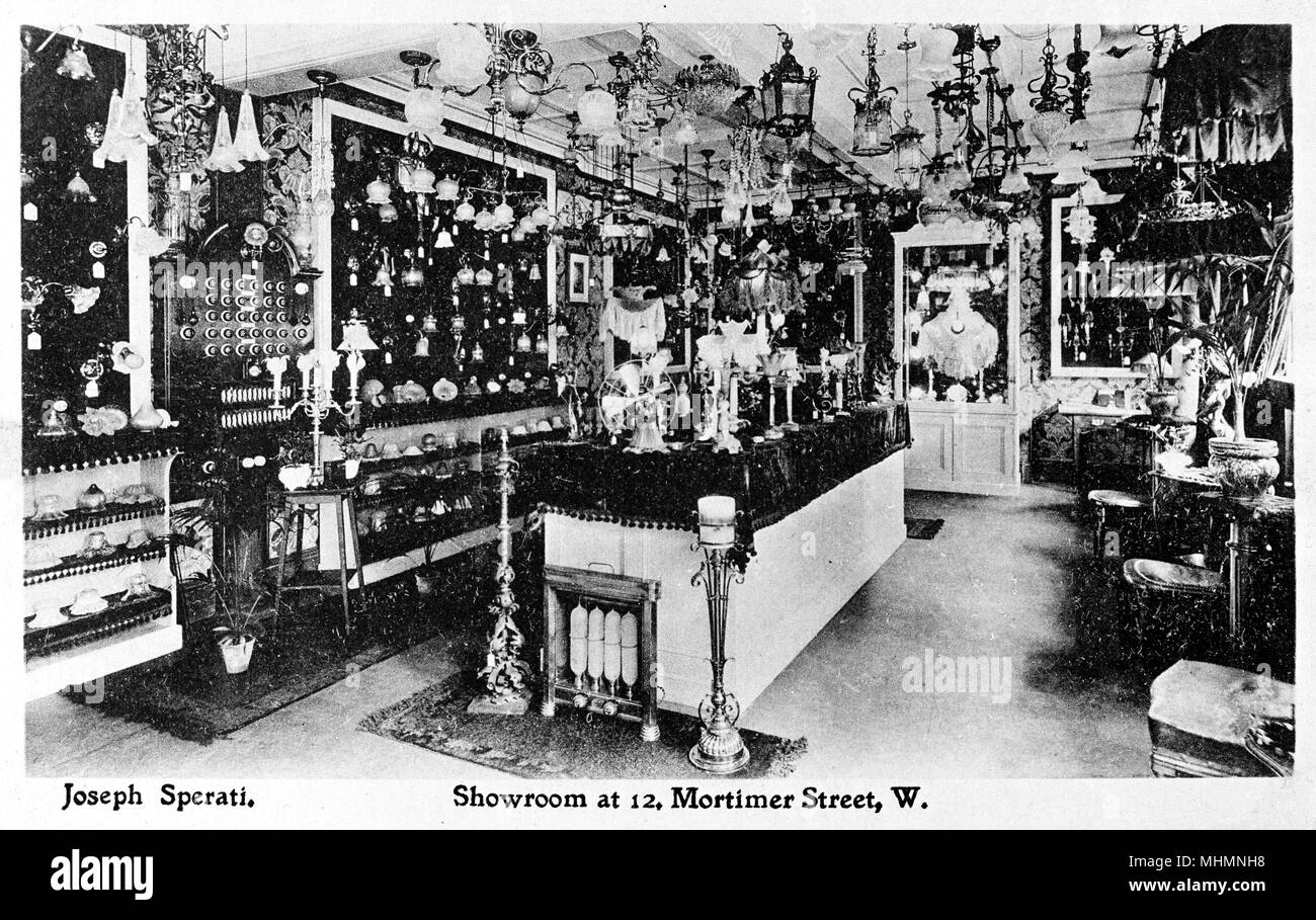 Joseph Spirati, Showroom displaying lamps and lampshades, 12 Mortimer Street, London.     Date: circa 1910 - Stock Image