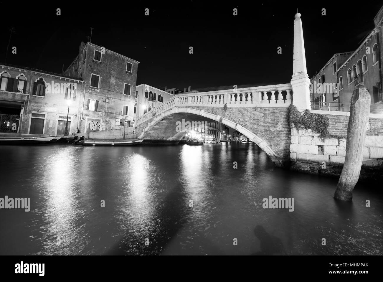 venice canals night view with light reflections in black and white - Stock Image