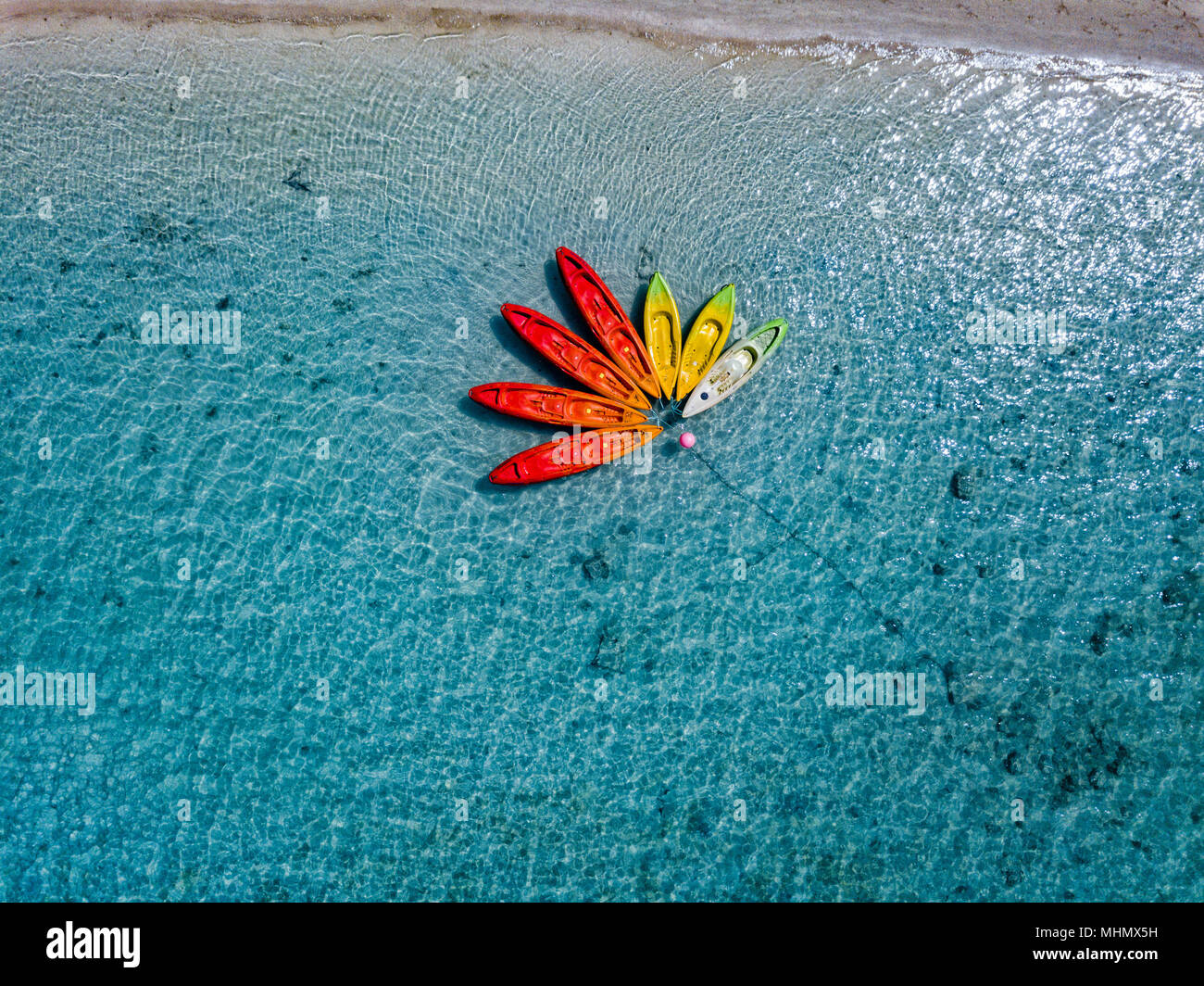 Canoe and kayaks like flower in Polynesia Cook Islands tropical paradise aerial view panorama landscape - Stock Image