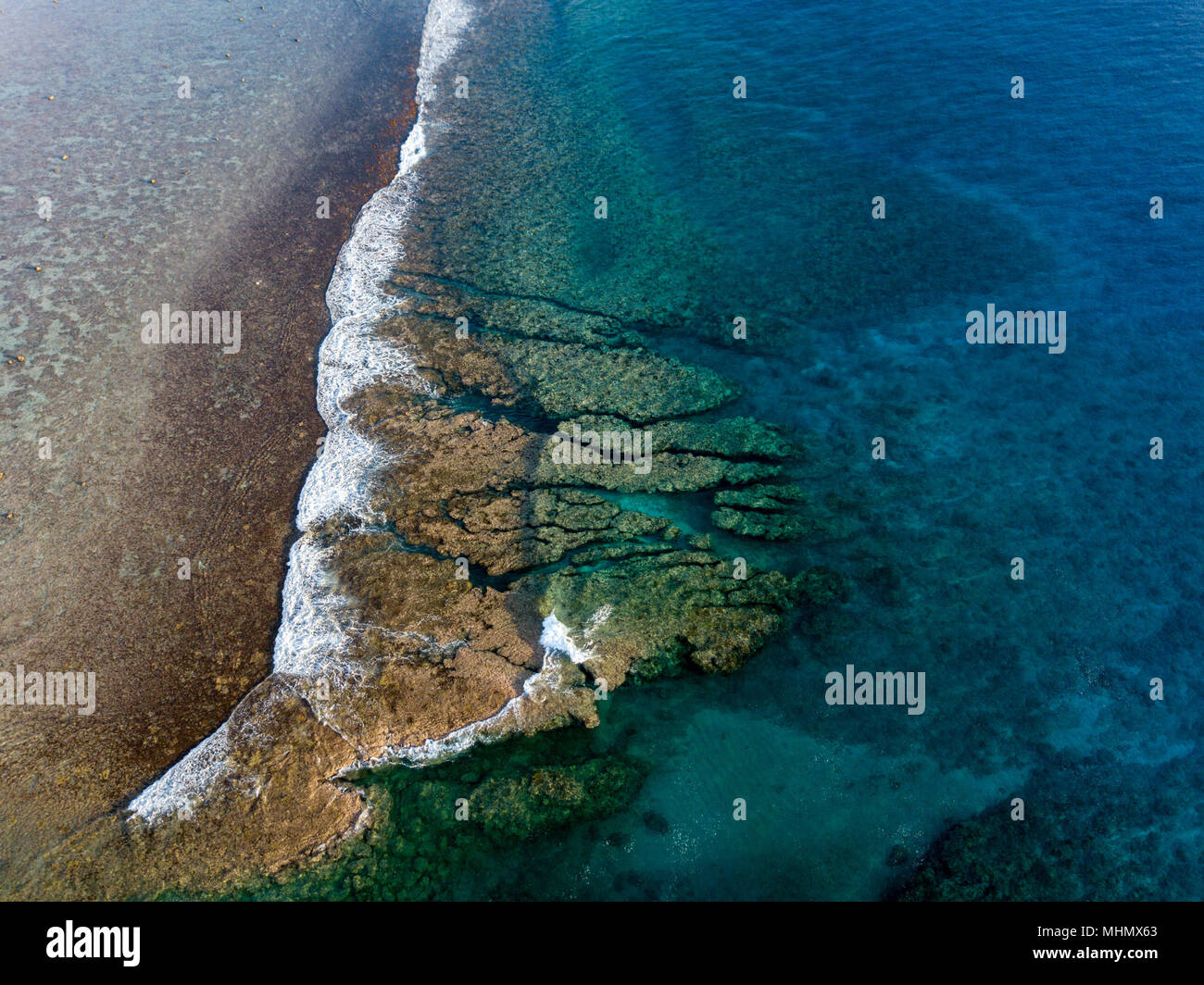 Pacific ocean reef waves Polynesia Cook Islands tropical paradise aerial view panorama landscape - Stock Image