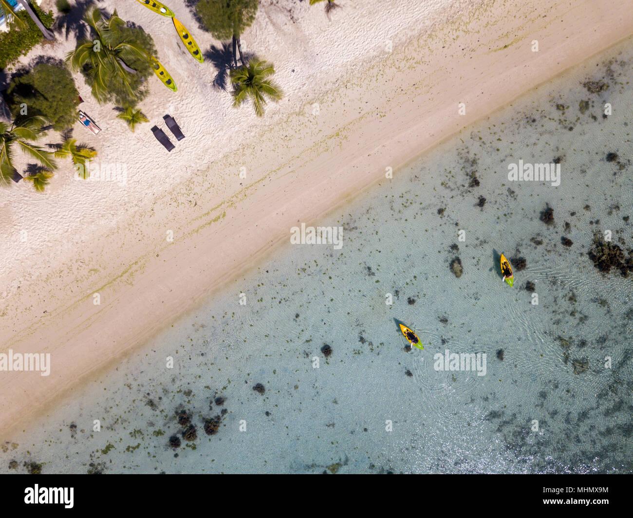 Canoe and kayaks in Polynesia Cook Islands tropical paradise Aitutaki panorama landscape - Stock Image