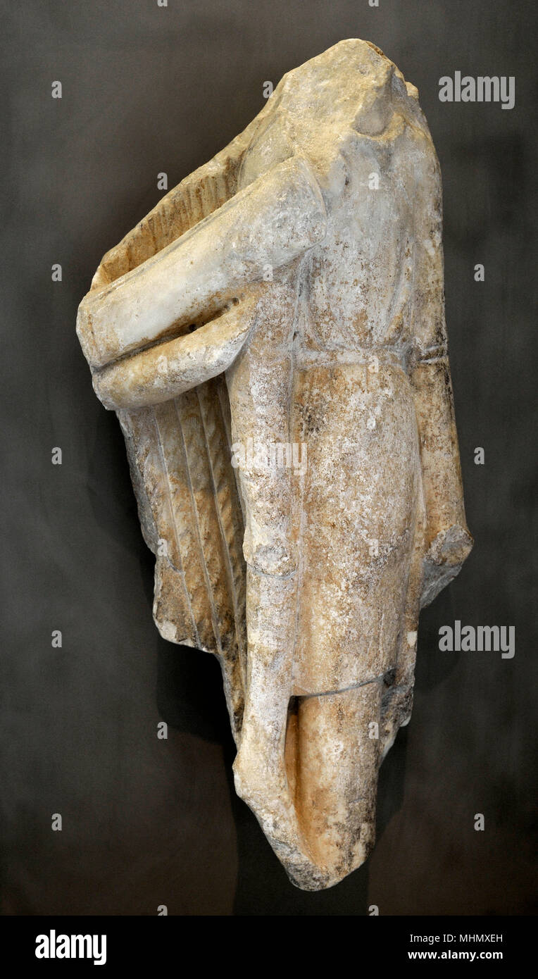 Greek art. The parapet of the Athena Nike temple. Trophy decorated with Persian armour. South side of the parapet. 5th century BC. Acropolis Museum. Athens. Greece.. - Stock Image