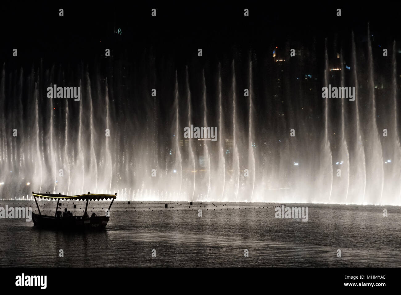 DUBAI, UAE - AUGUST 14 2017 - The show takes places every 30 minutes at the mall and is the world's second largest choreographed fountain system - Stock Image