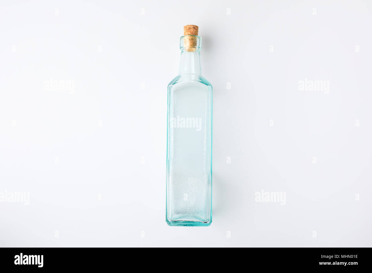 transparent glass bottle with plug - Stock Image