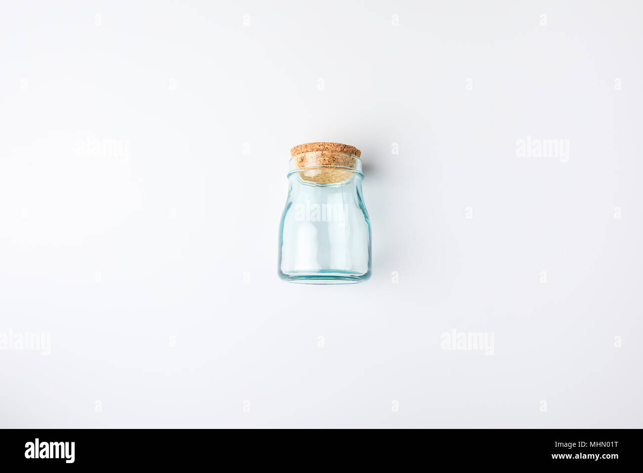 transparent glass bottle with bung - Stock Image