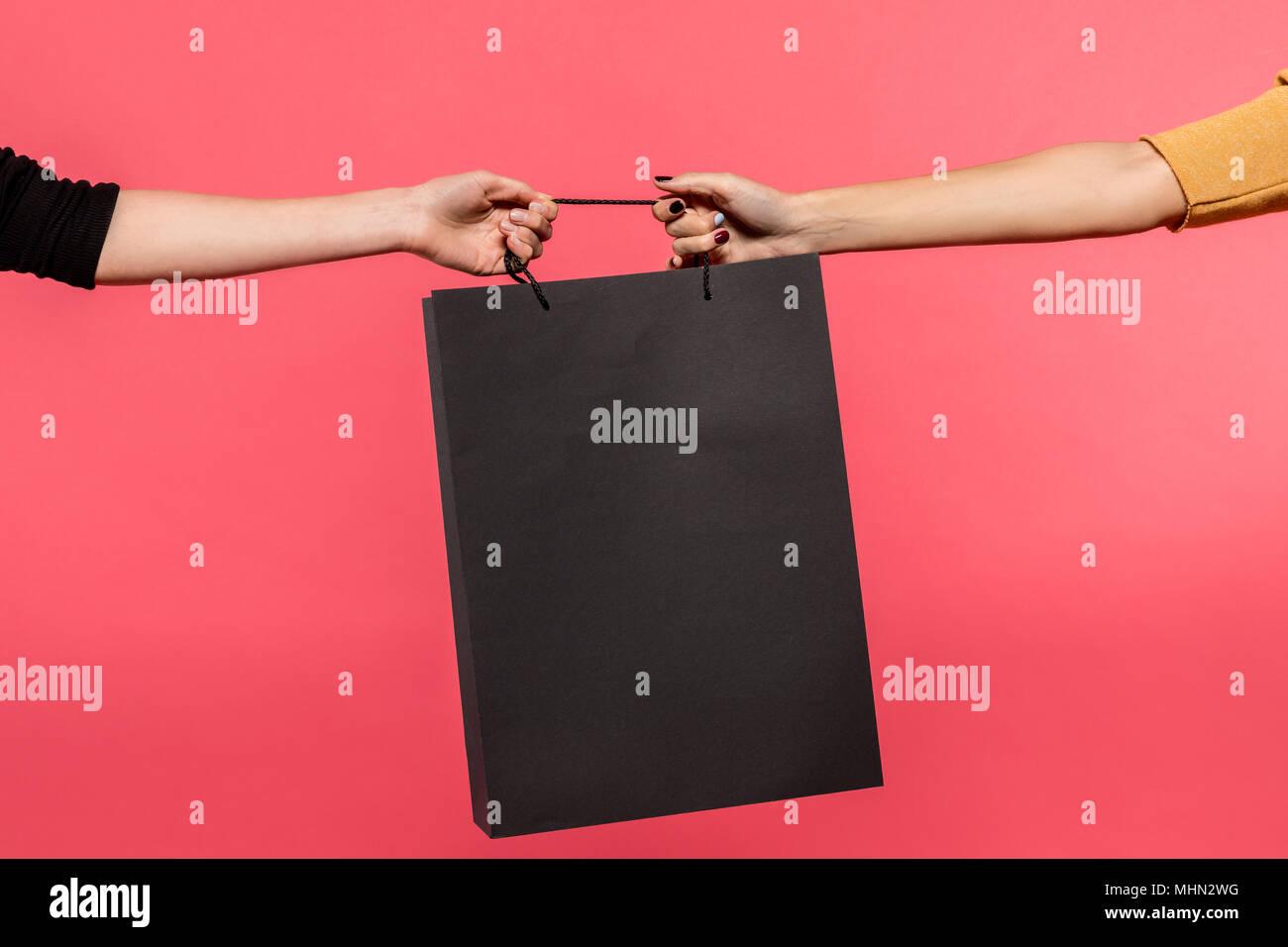 women pulling shopping bag - Stock Image